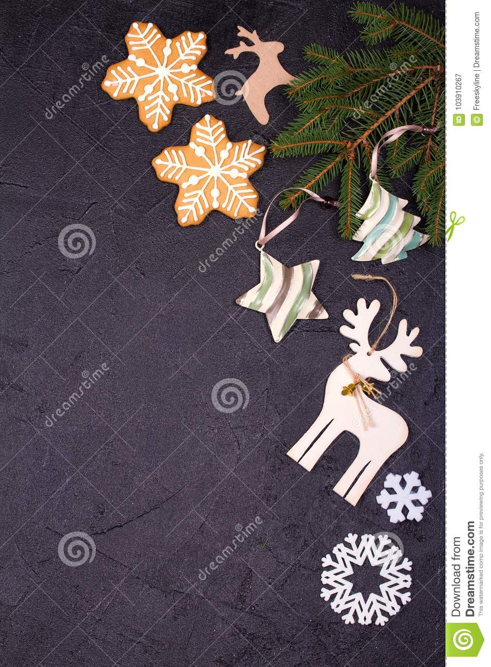 christmas and new year border or frame on black background winter holidays concept view from above top studio shot vertical