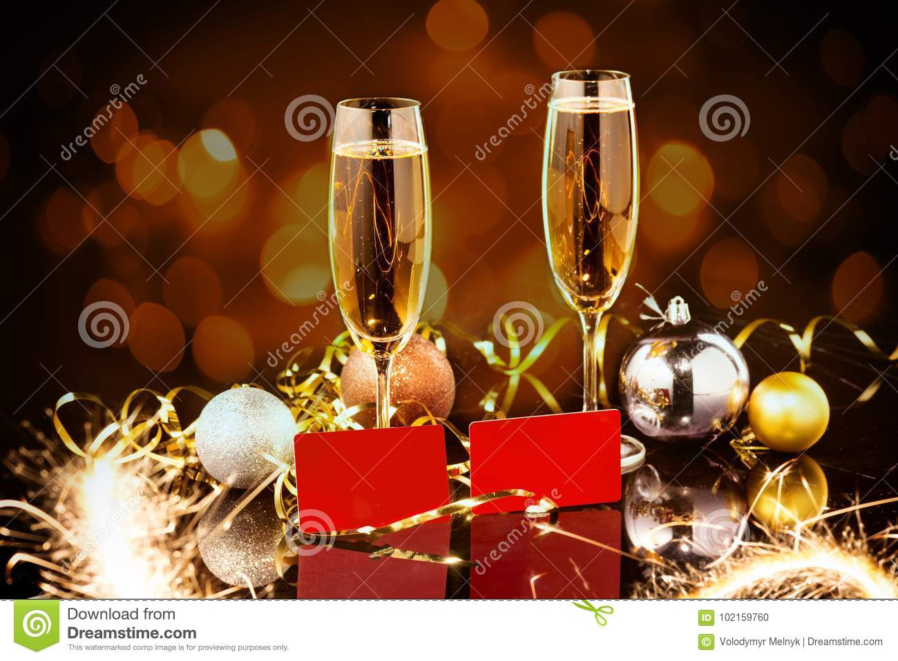 Christmas and New Year celebration with champagne. New Year holiday decorated table. Two Champagne Glasses