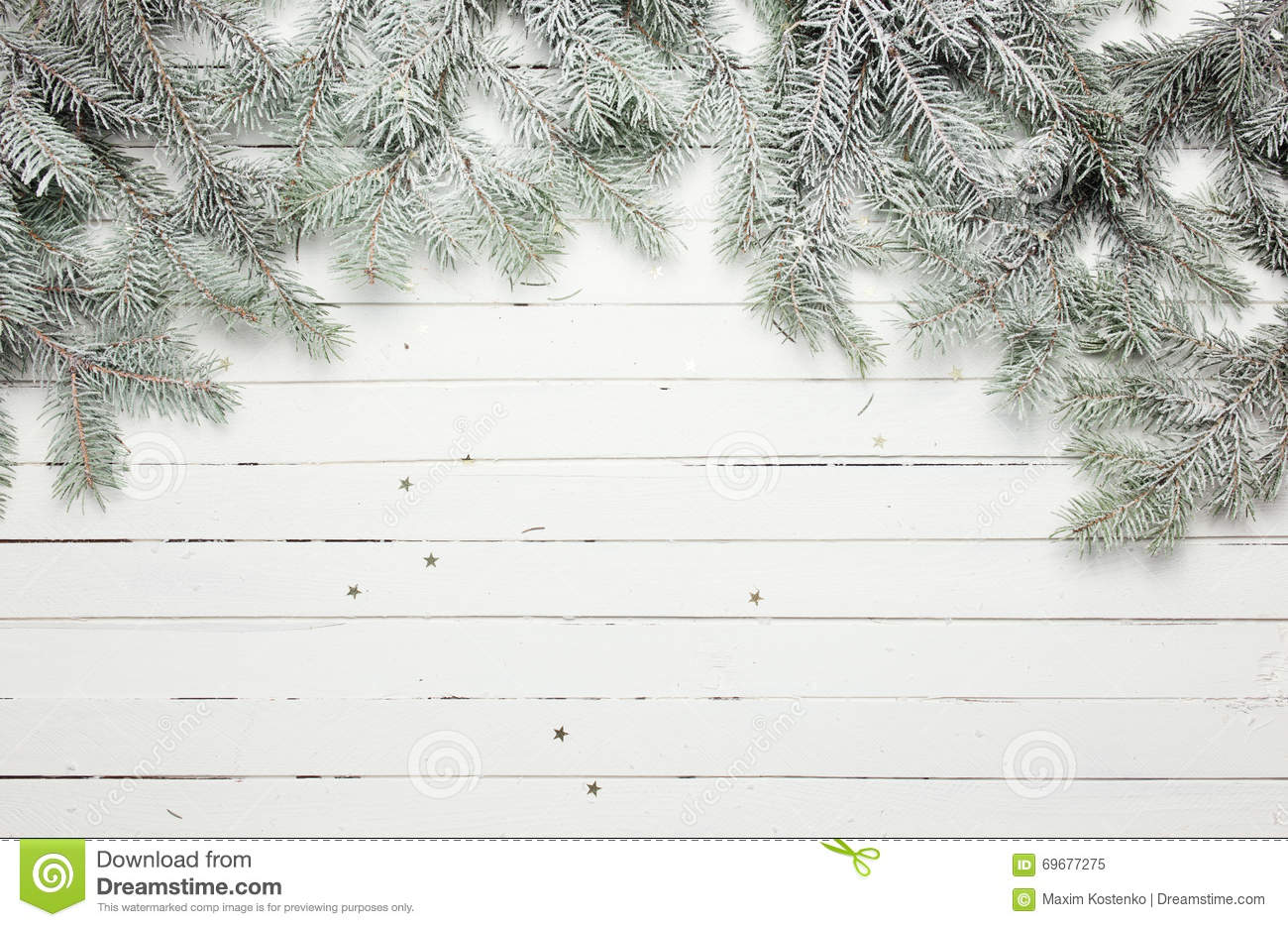Christmas and New Year decoration composition. Top view of fur-tree branches on wooden background with place for your
