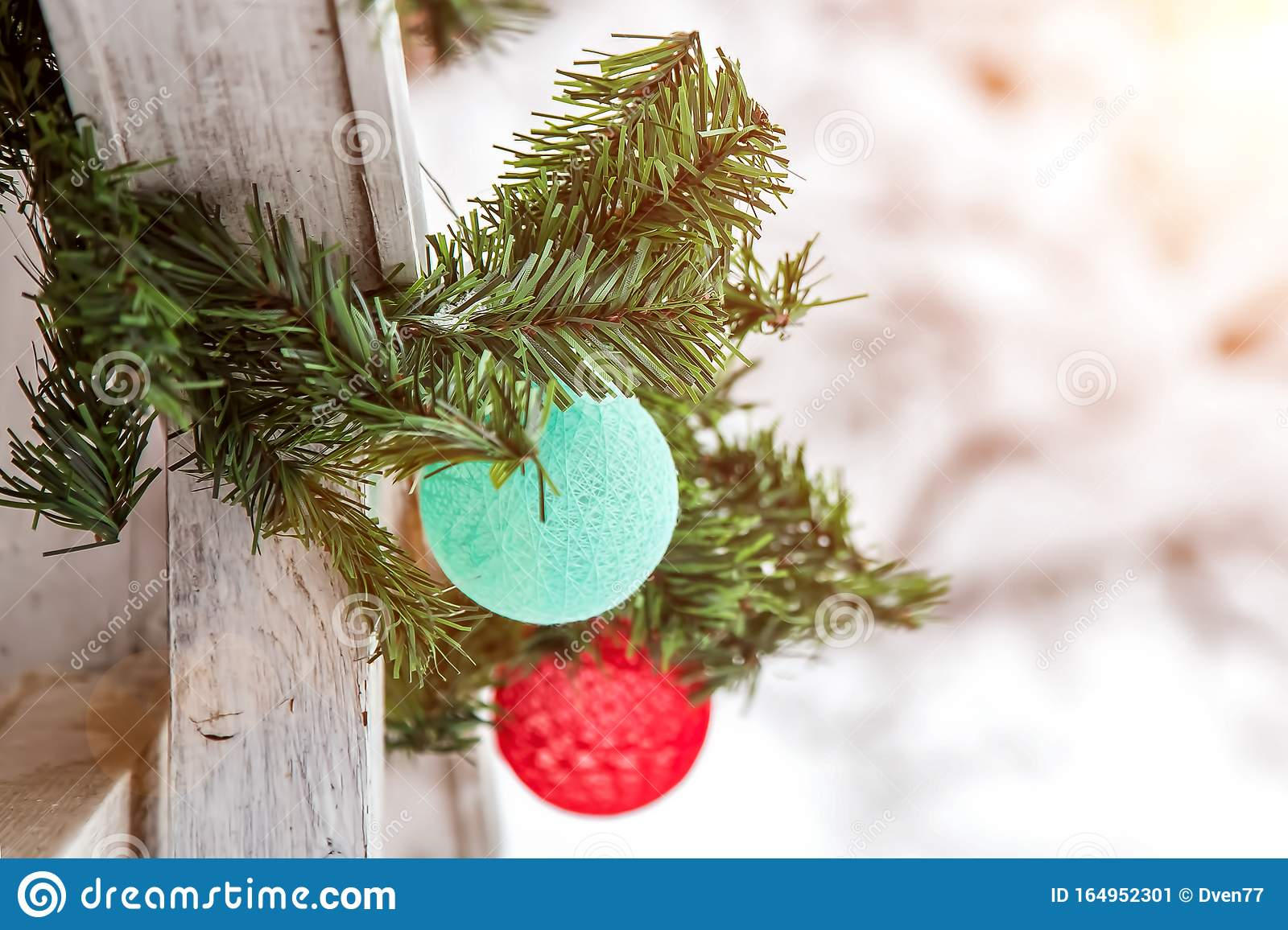 Christmas And New Year Decorations On The Street In The Snow A Mint And Red Balls Of Garland In The Form Of A Ball Of Thread Stock Image Image Of Pine