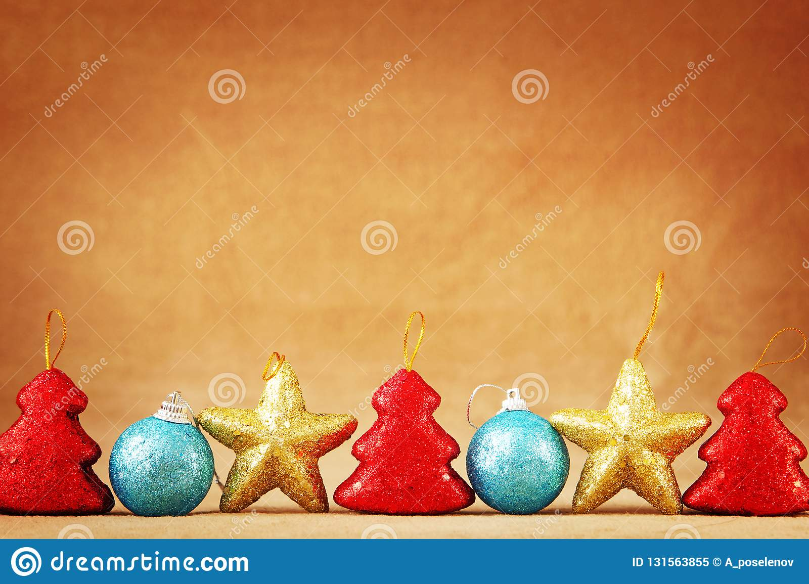christmas or new year festive brown background with a bottom border made of christmas toys