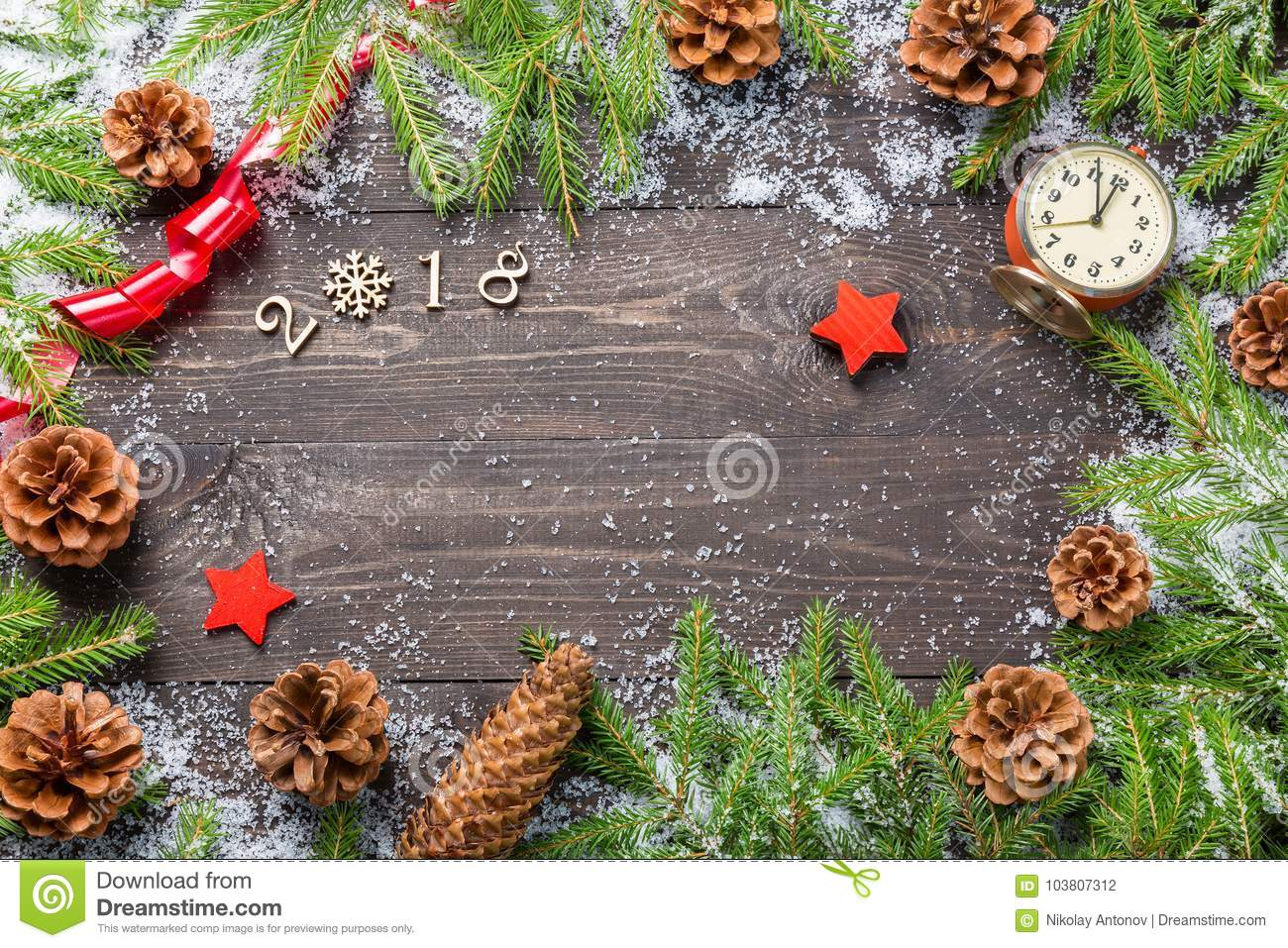 Christmas or new year frame for your project with copy space. Christmas fir trees in snow with cones, vintage clock, decorative st