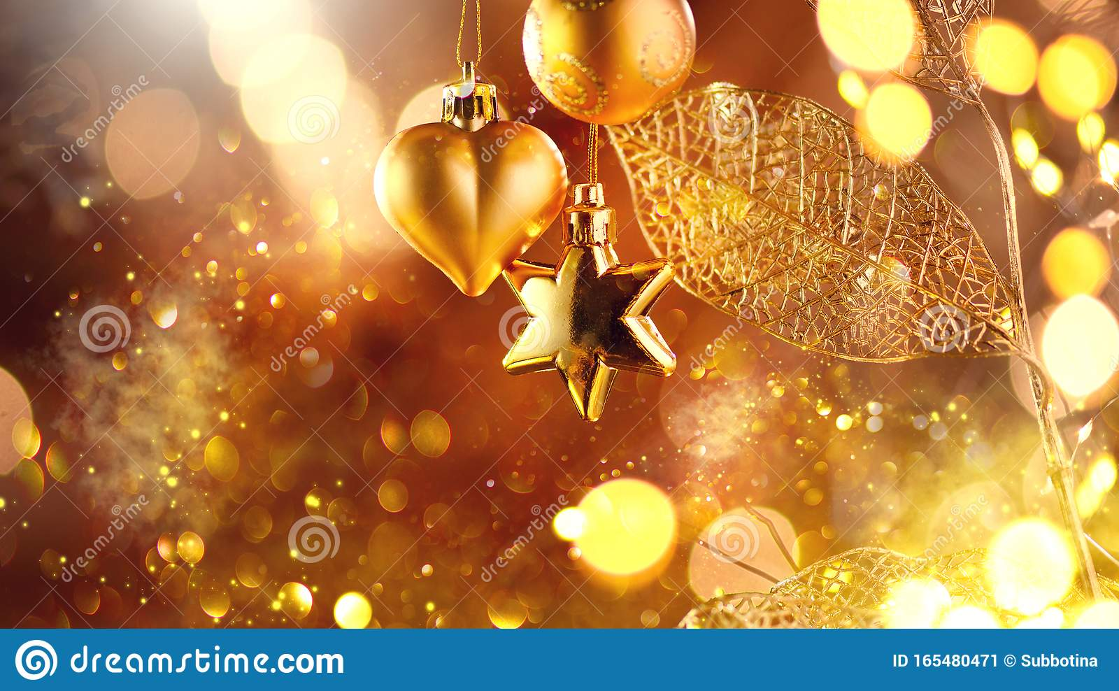 Christmas and New Year golden Decoration. Abstract Blurred Bokeh Holiday Background with beautiful baubles and Blinking Garland