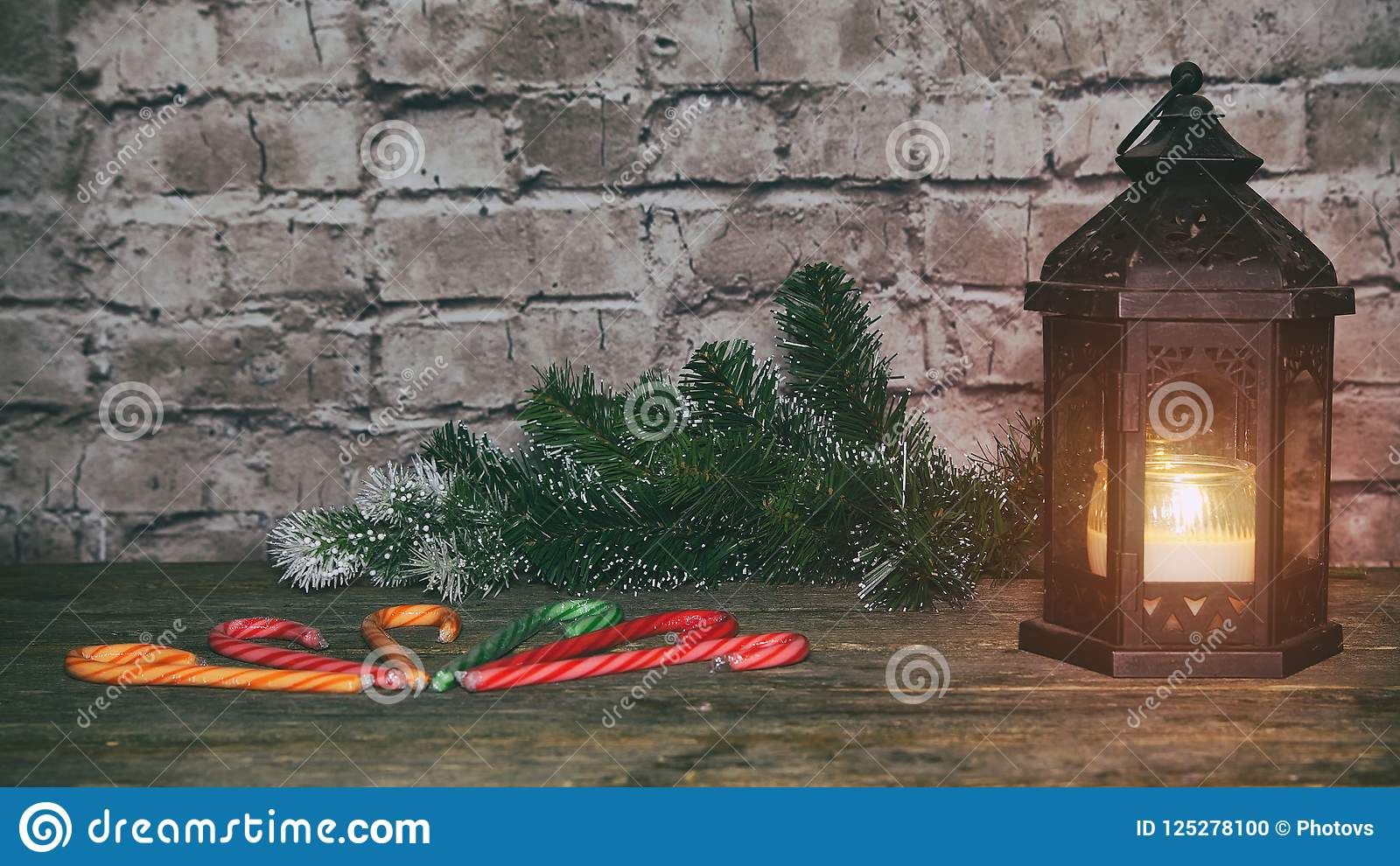 Christmas New Year holiday background. gingerbread cookies and fir branch tree table.