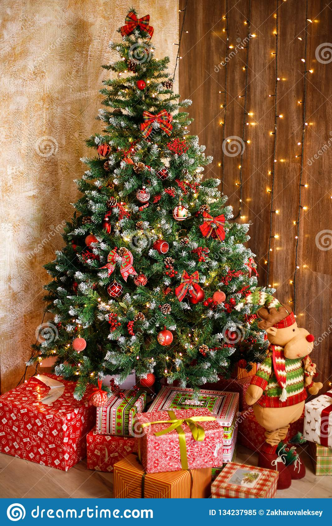 Christmas New Year Interior With Red Brick Wall Background Decorated Christmas Tree With Garlands And Balls Dark Box And Horse Stock Image Image Of Gold Garland 134237985