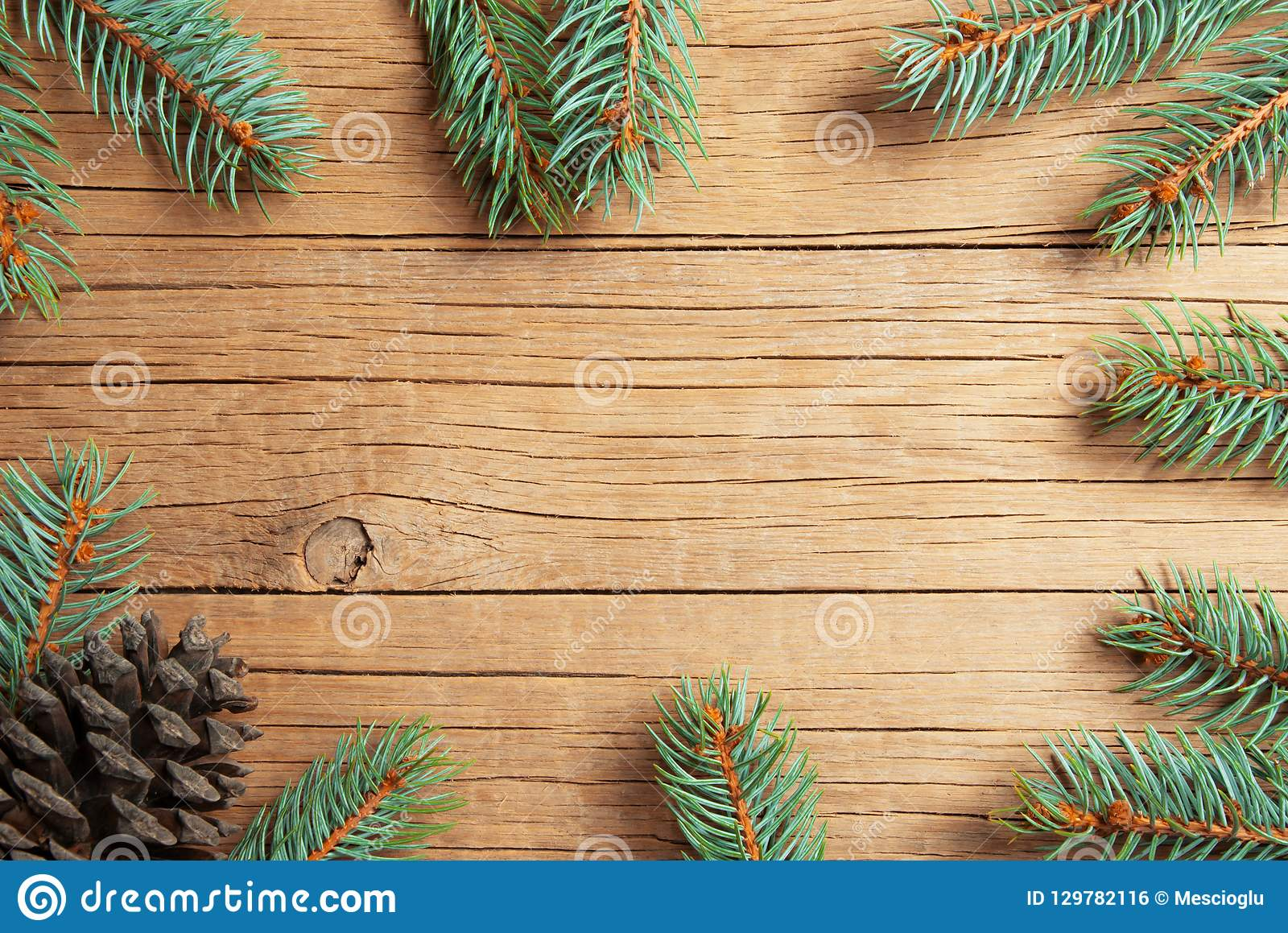christmas new year pine tree and cones decoration background xmas and christmas on wooden table