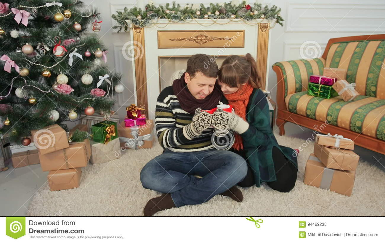 christmas and new year themes a young couple enjoys each other for cupping hot coffee a room with a christmas tree and stock video video of home