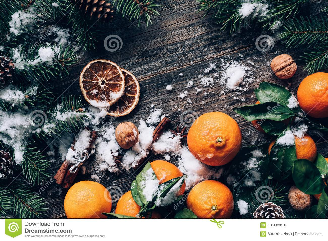christmas or new year wallpaper background with tangerines fir tree spices and snow