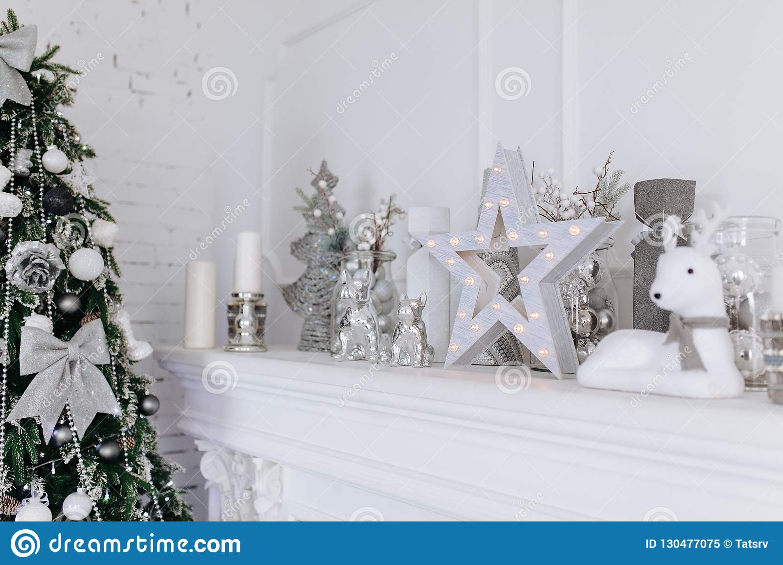 Christmas And New Year White And Silver Decorations On Fireplace In ...