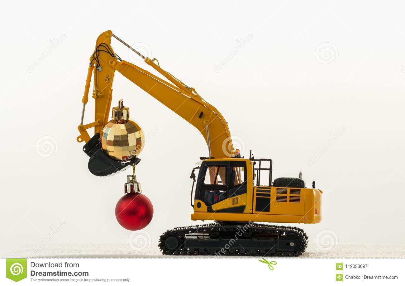 Christmas ornament and excavator model holiday celebration