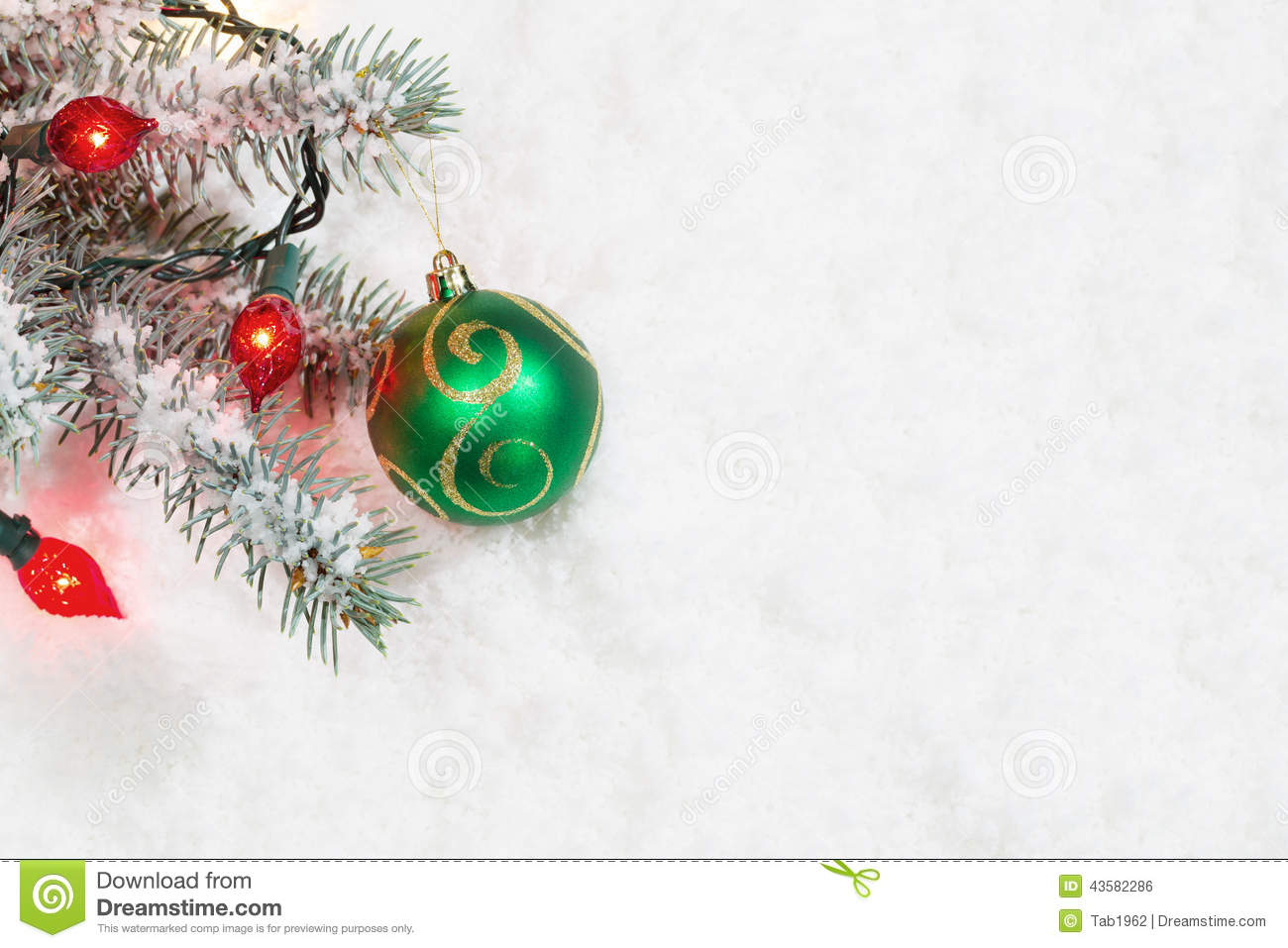 Christmas ornament with lights hanging from tree branch