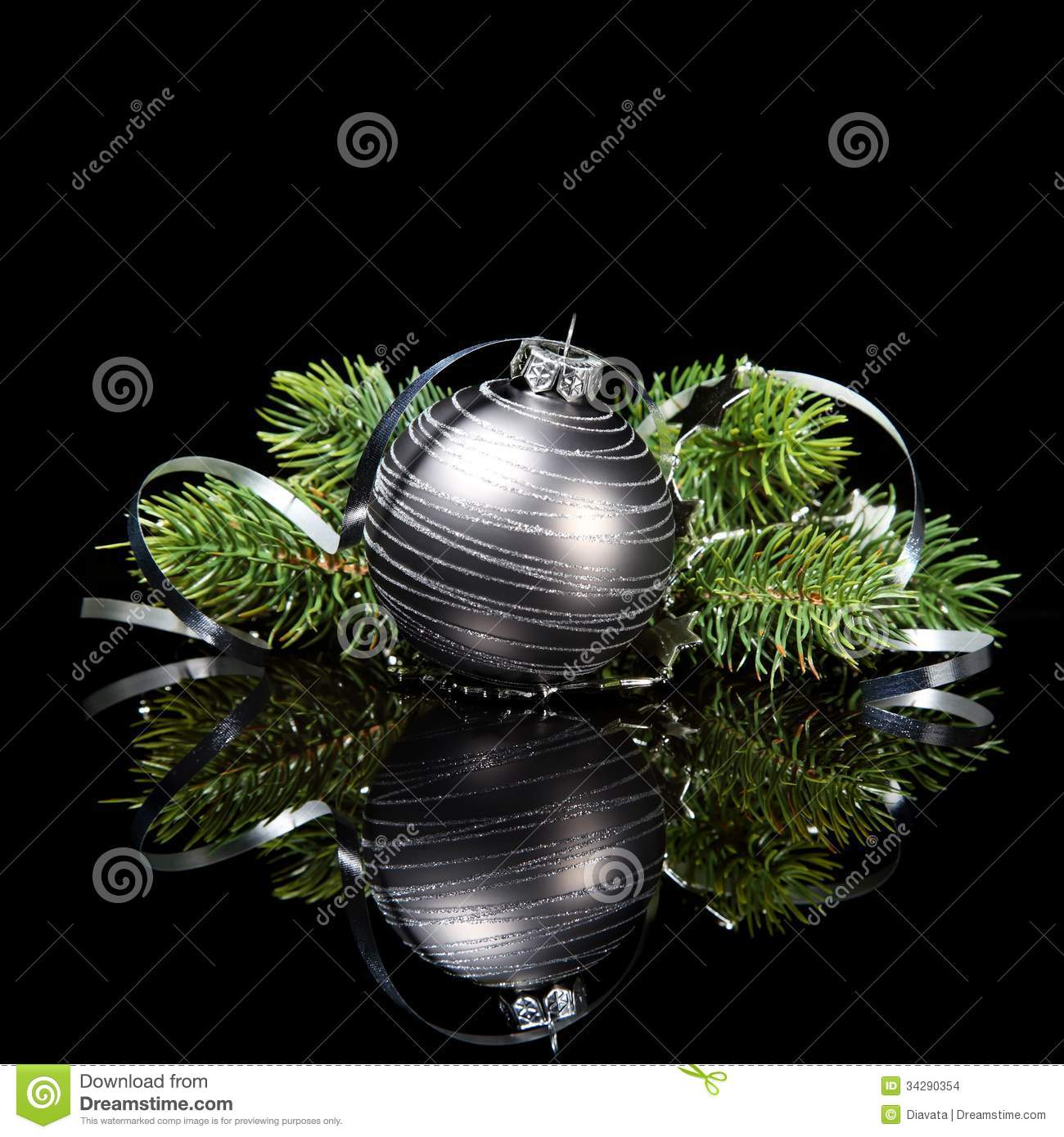Christmas Ornament With Pine Tree Branches On A Bl Stock Photo