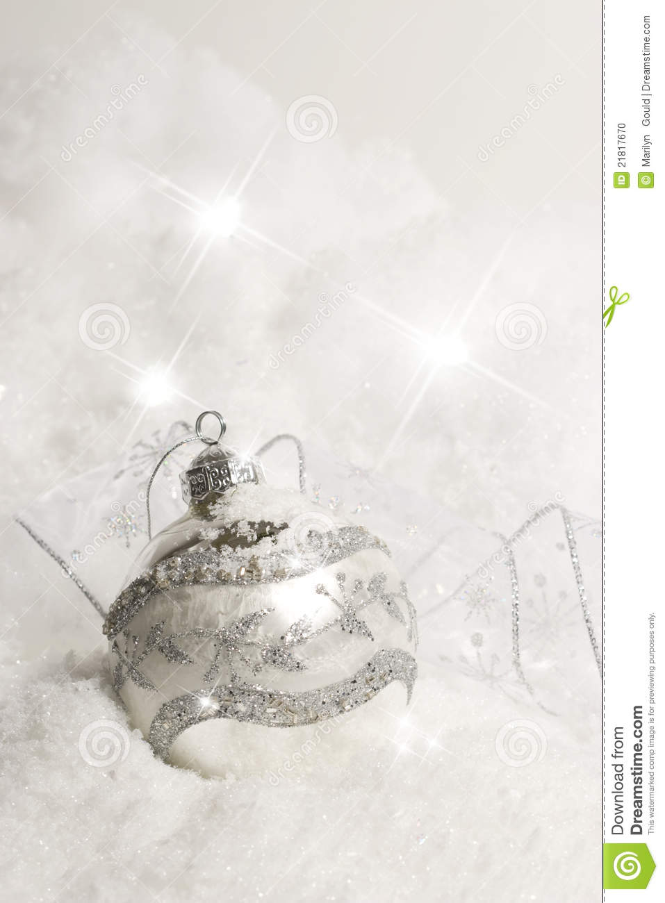 Christmas ornament in snow vertical stock photo image