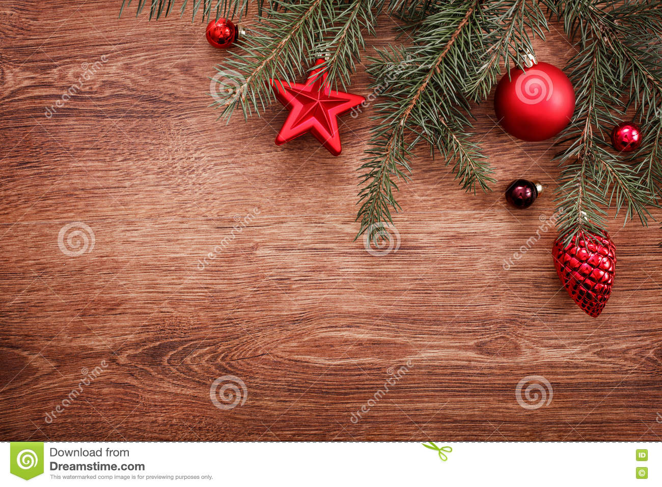 Christmas ornaments and fir tree branch on a rustic wooden background. Xmas card. Happy New Year. Top view