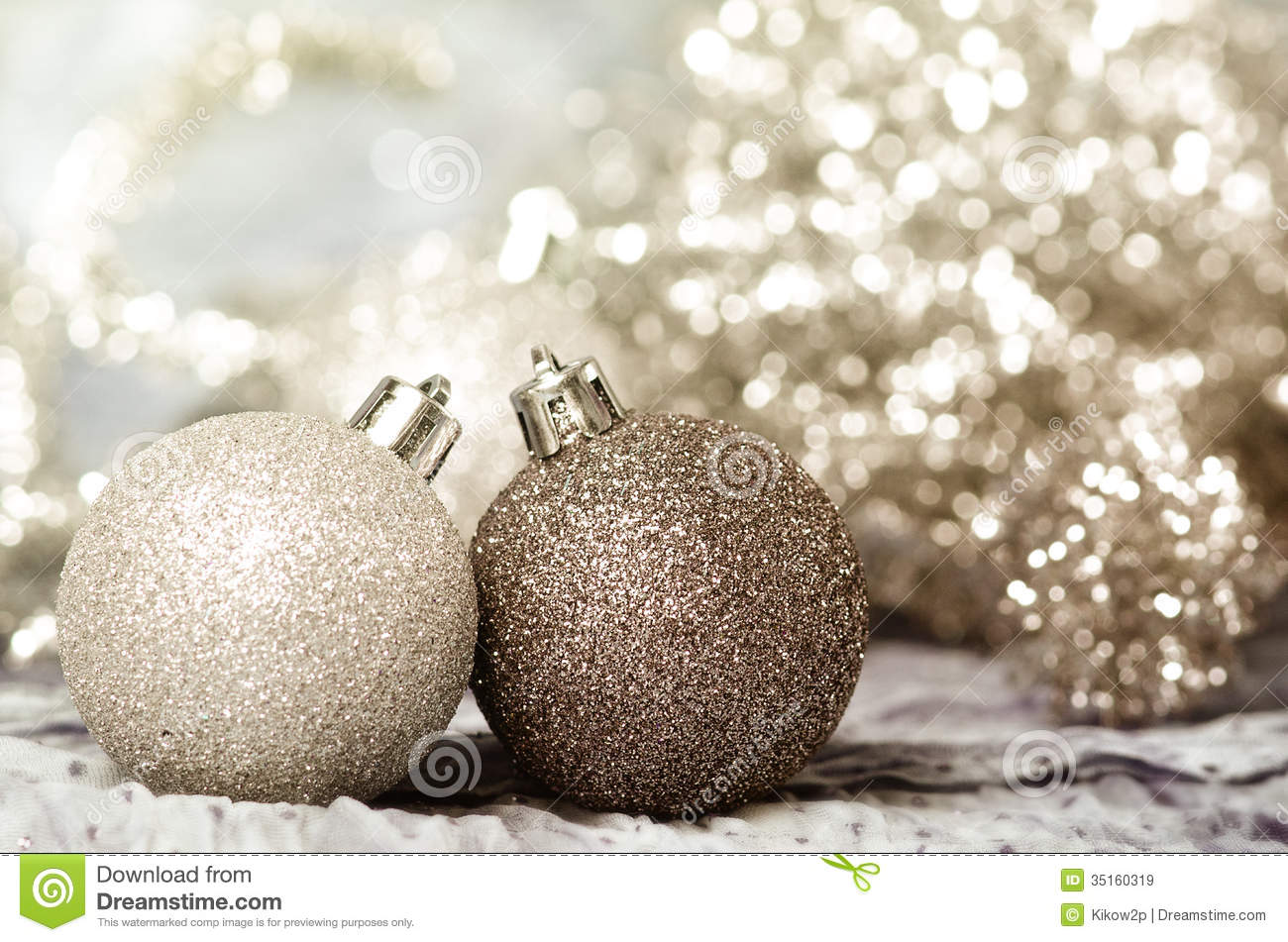 christmas ornaments of gold and silver