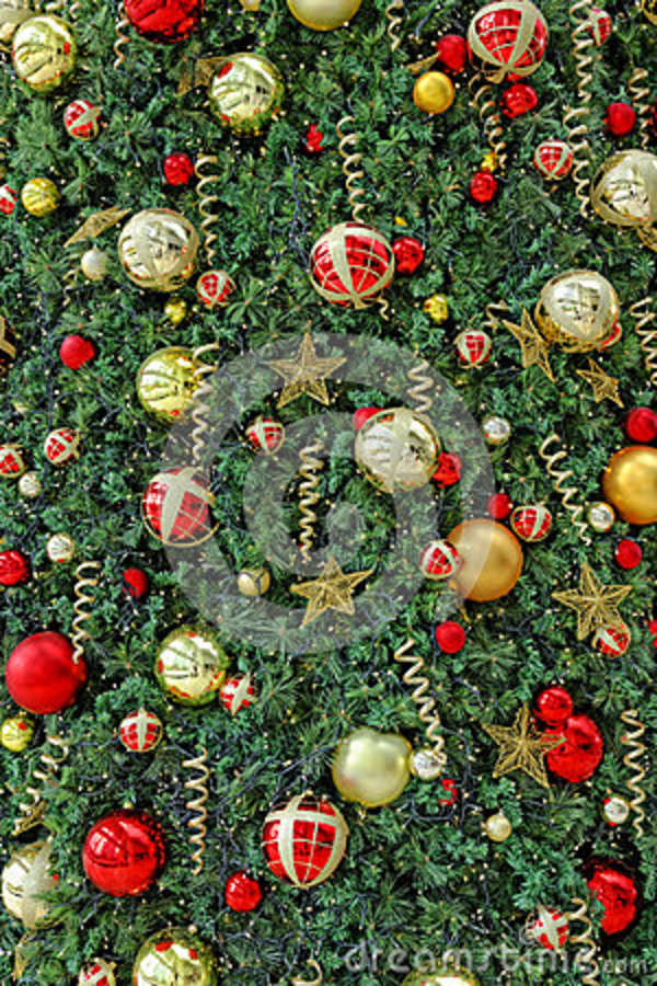 Christmas ornaments in greenery background stock photo