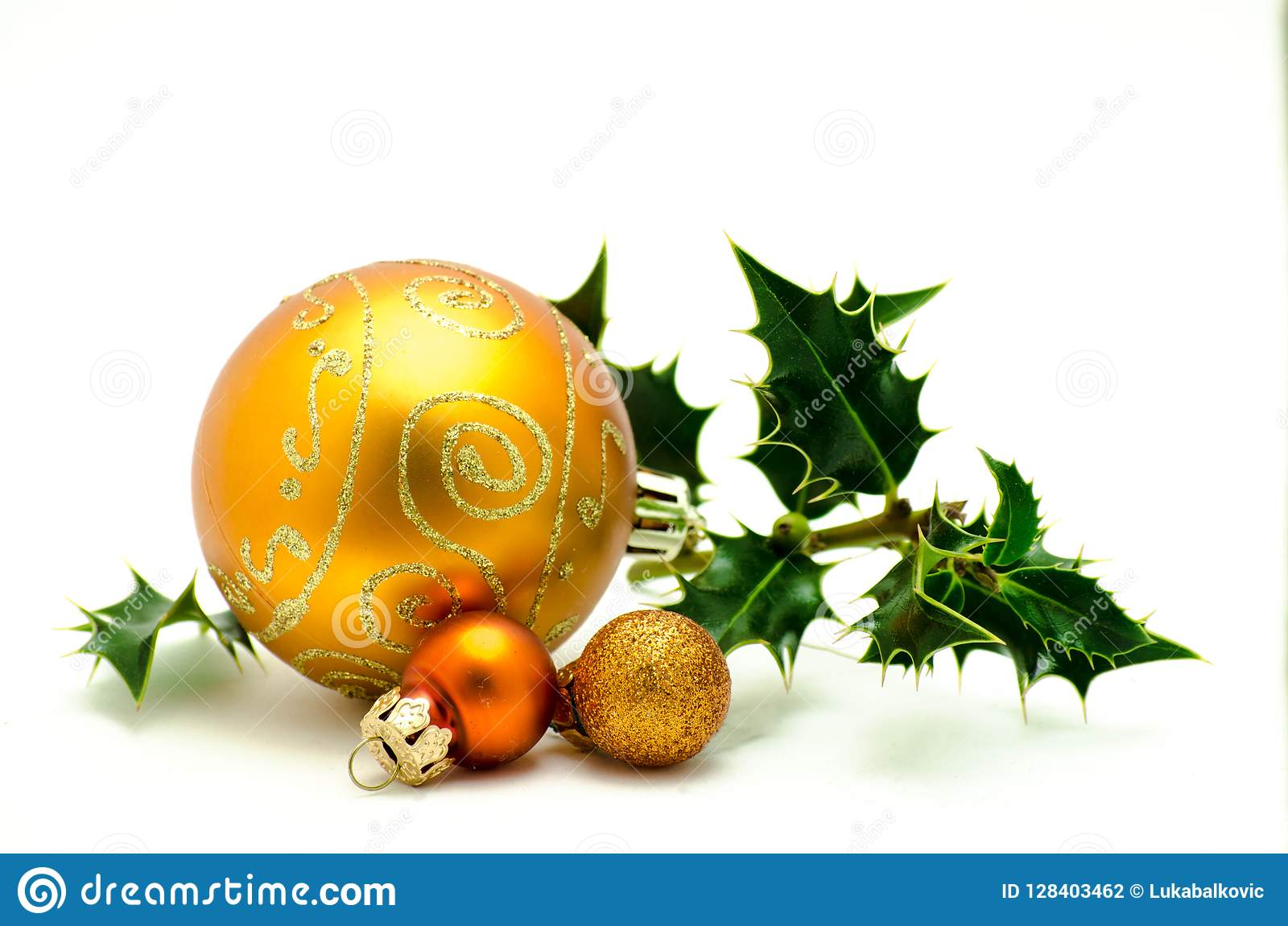 Christmas ornaments - orange ball with green holly
