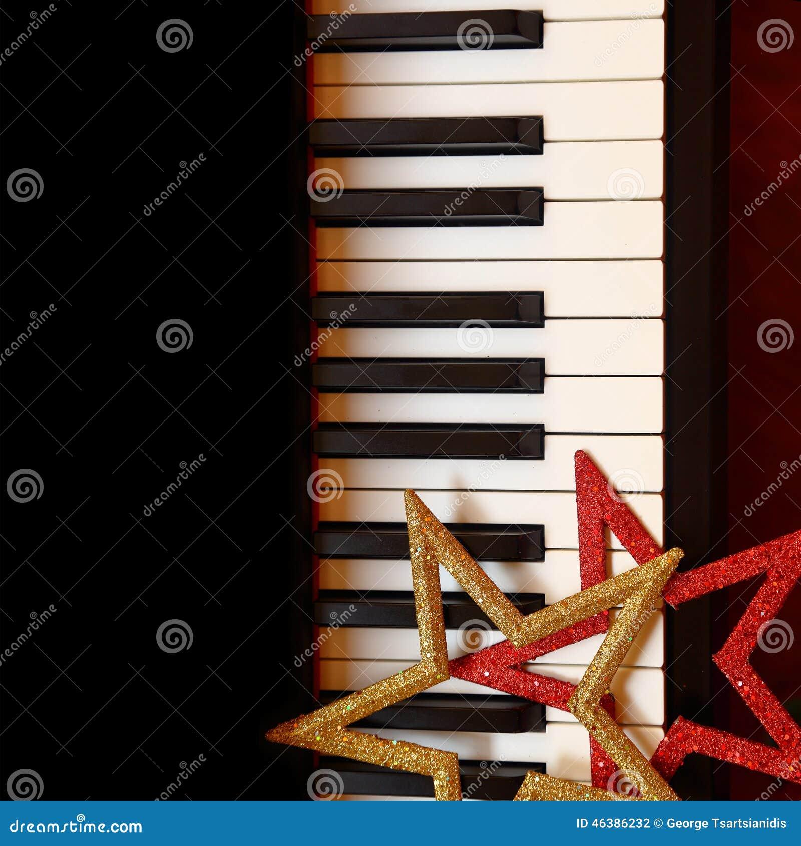 Christmas ornaments on piano stock photo image