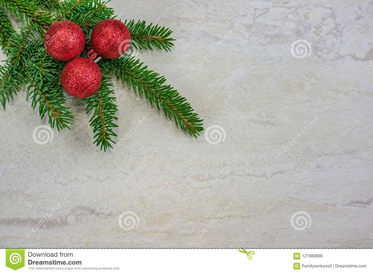 Christmas ornaments on a spruce bough with copy space