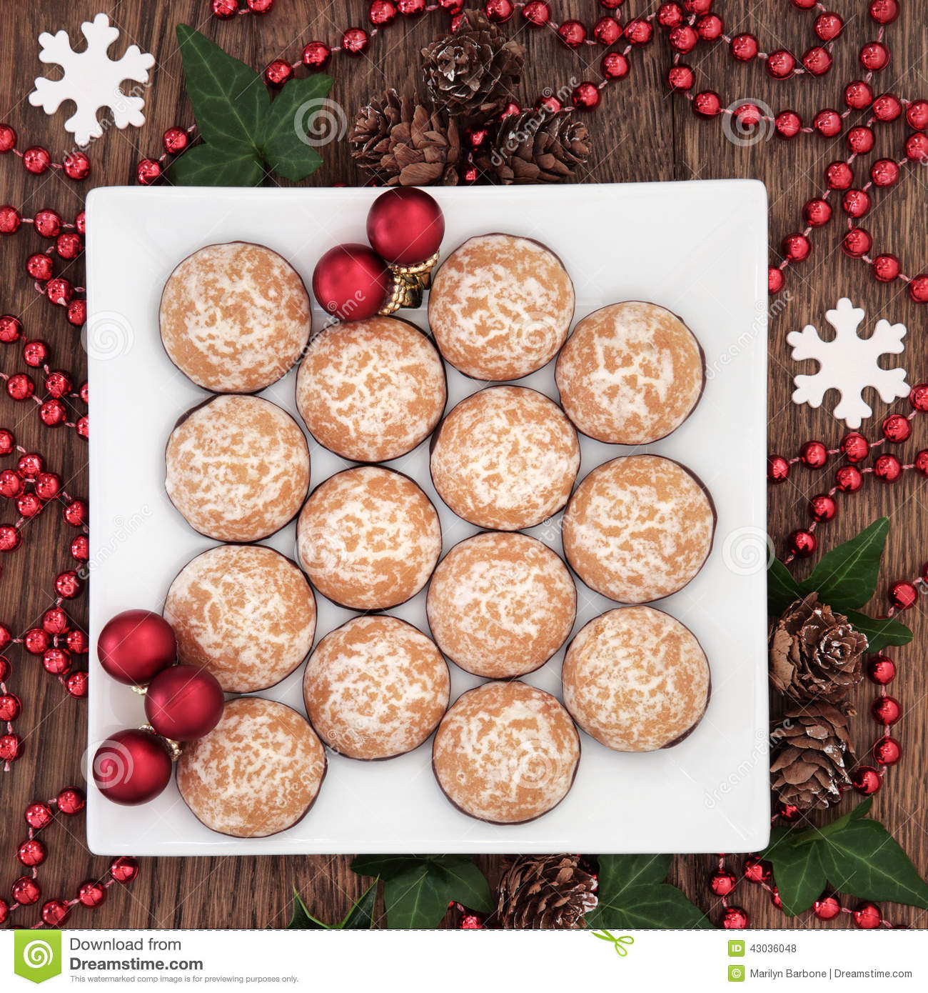 Christmas Biscuit Background With Snowflakes Winter Greenery And Red Bauble Decorations Over Old Oak Wood Table
