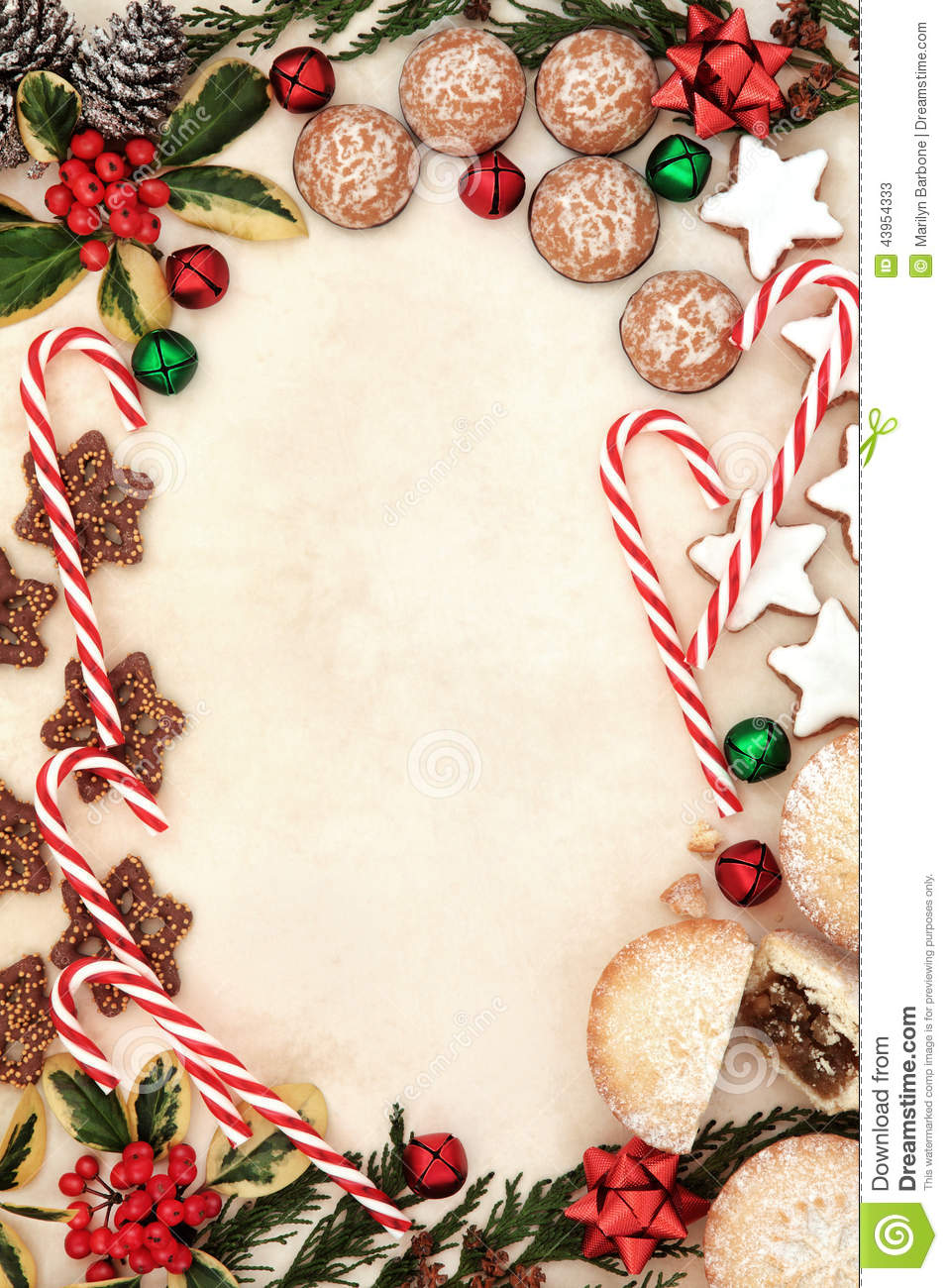 Christmas gingerbread biscuits, candy canes and mince pies forming an ...