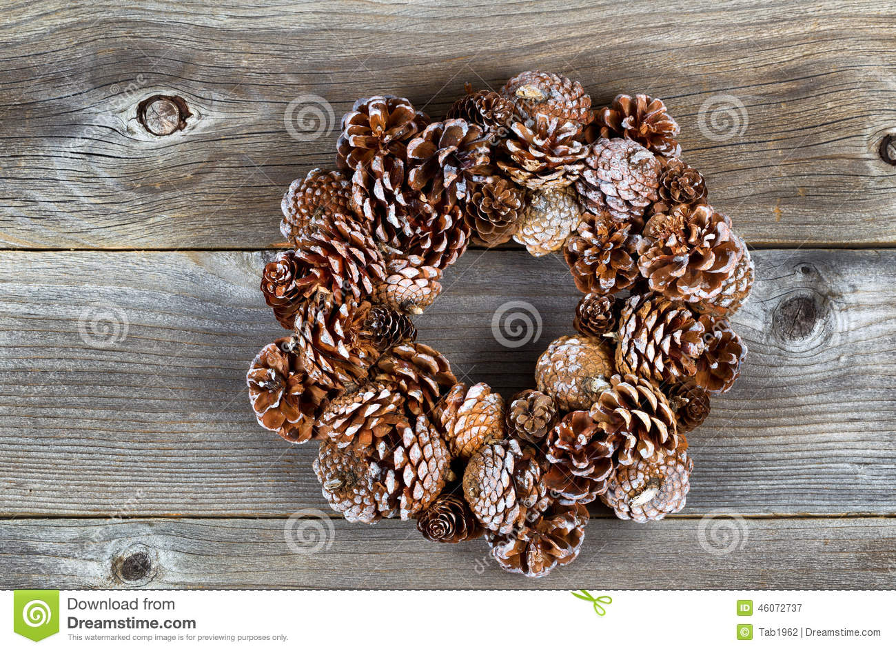 Christmas pine cone wreath on rustic wood stock image