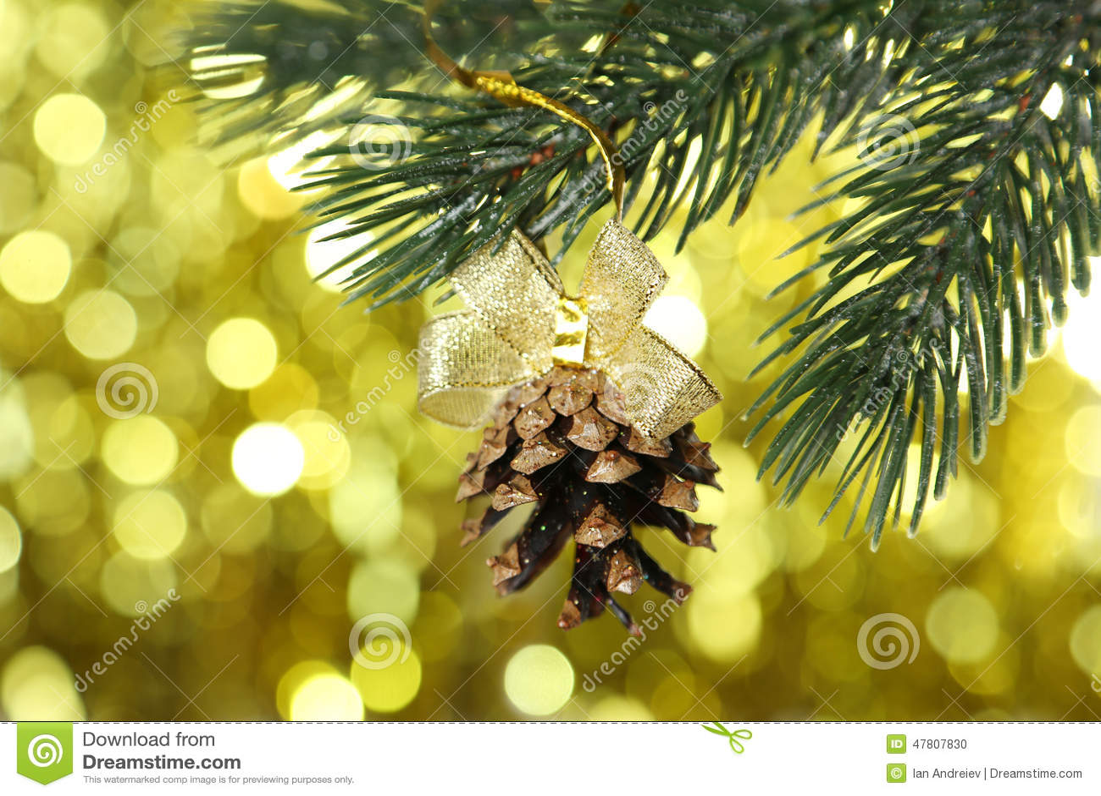 Christmas Pinecone On Christmas Tree On Lights Background Stock ...