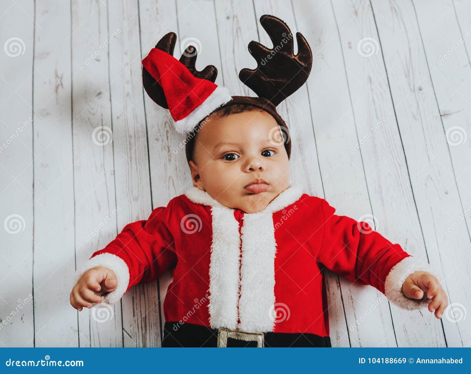 f5837c1ba Christmas Portrait Of Adorable Newborn Baby Wearing Santa Claus ...
