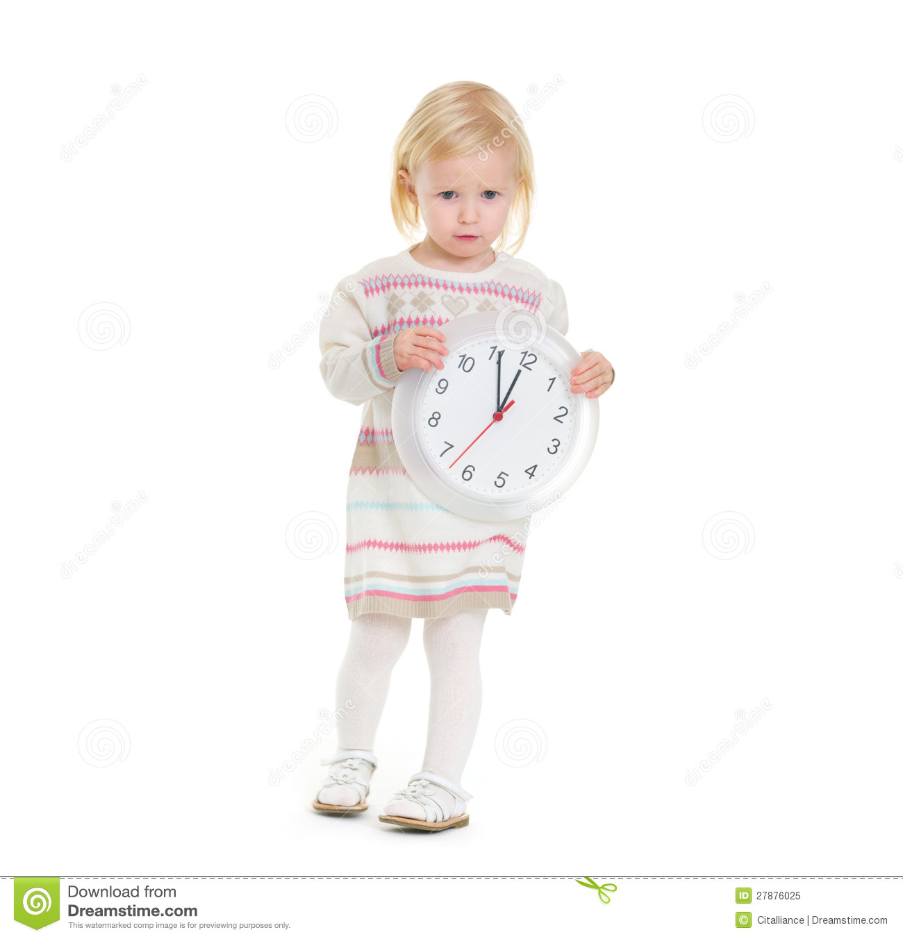 christmas portrait of baby girl holding clock royalty free