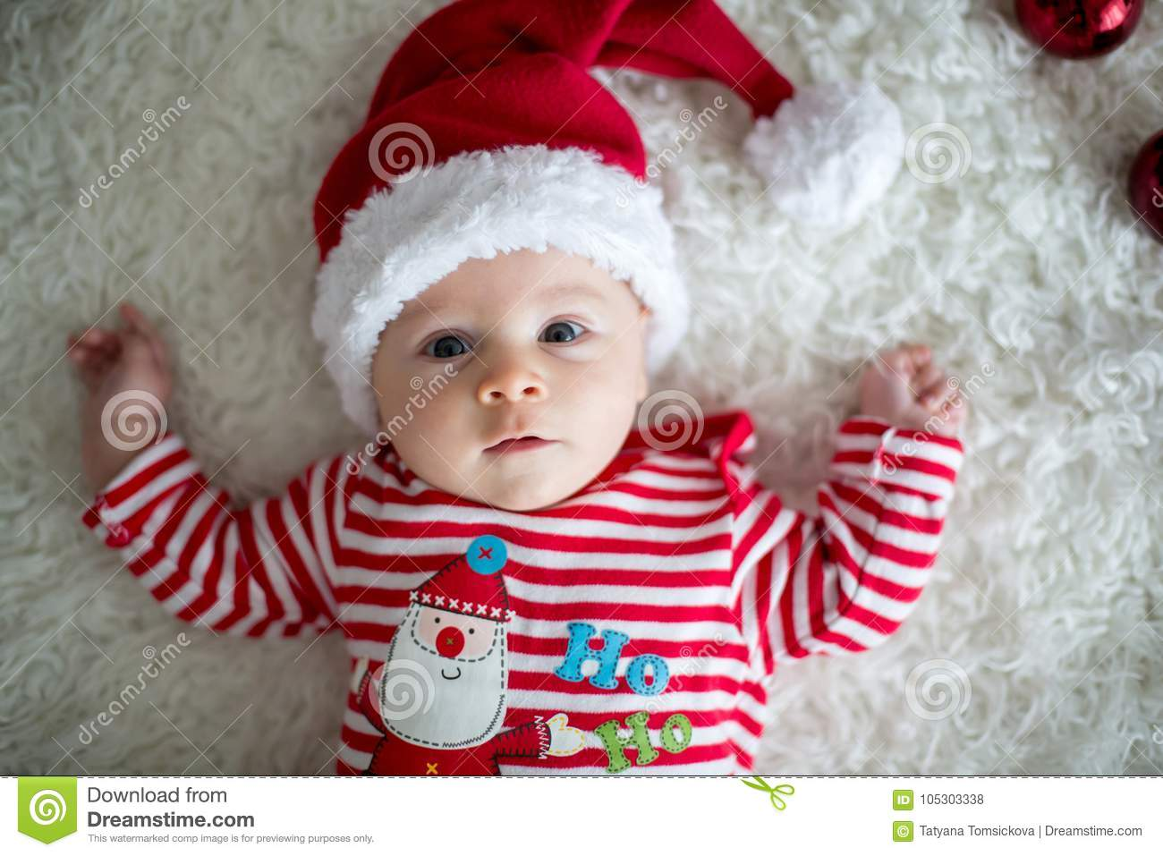 31d82f2a9302e Christmas portrait of cute little newborn baby boy, dressed in christmas  clothes and wearing santa hat, studio shot, winter time