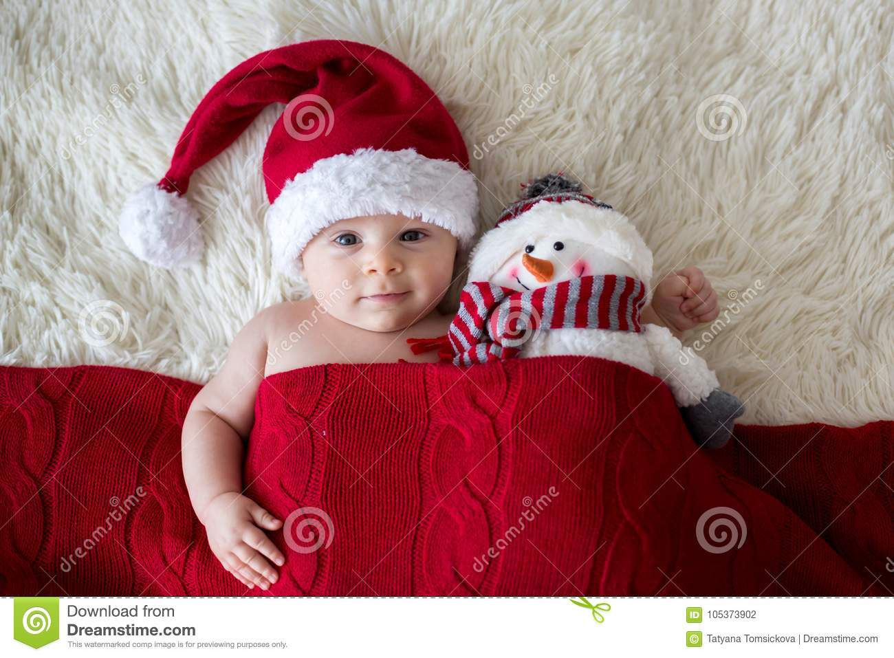 Christmas portrait of cute little newborn baby boy, wearing santa hat