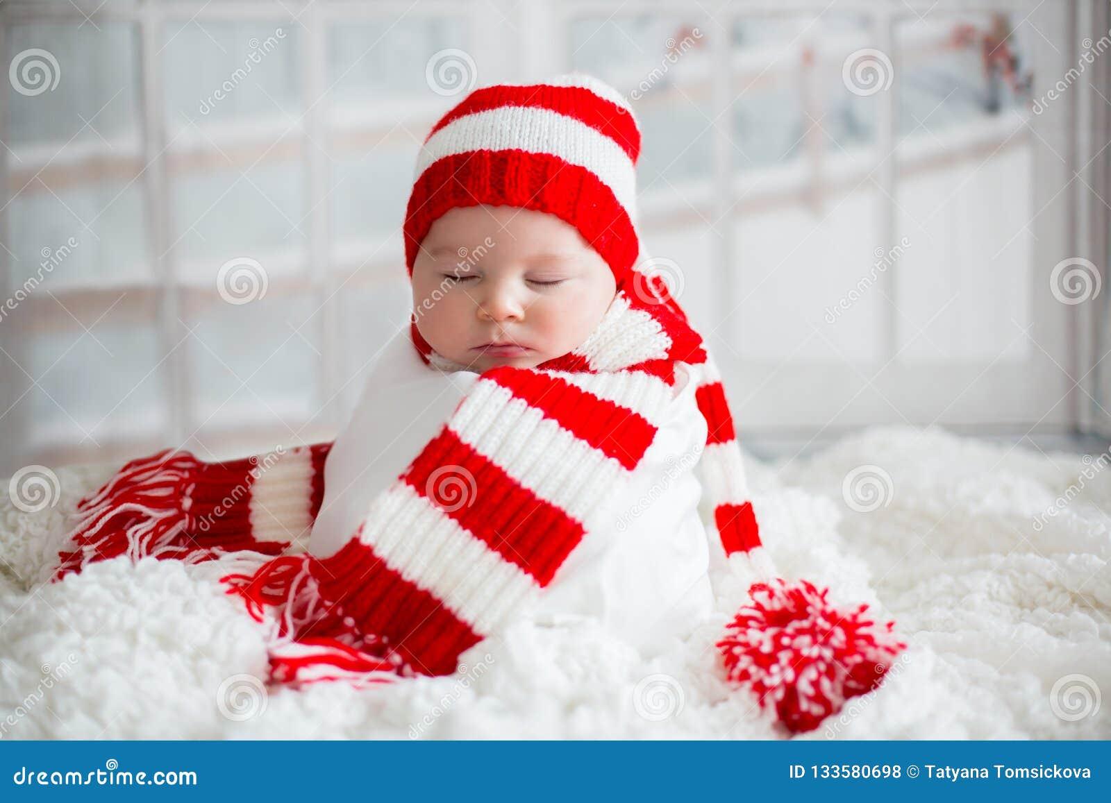 cbe9ada61 Christmas Portrait Of Cute Little Newborn Baby Boy, Wearing Sant ...