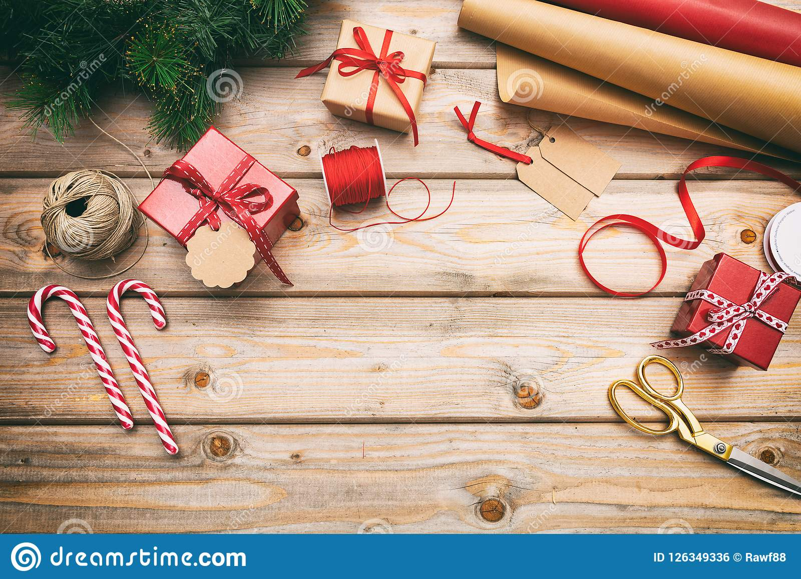 Christmas gift boxes wrapping on wooden background, copy space, top view