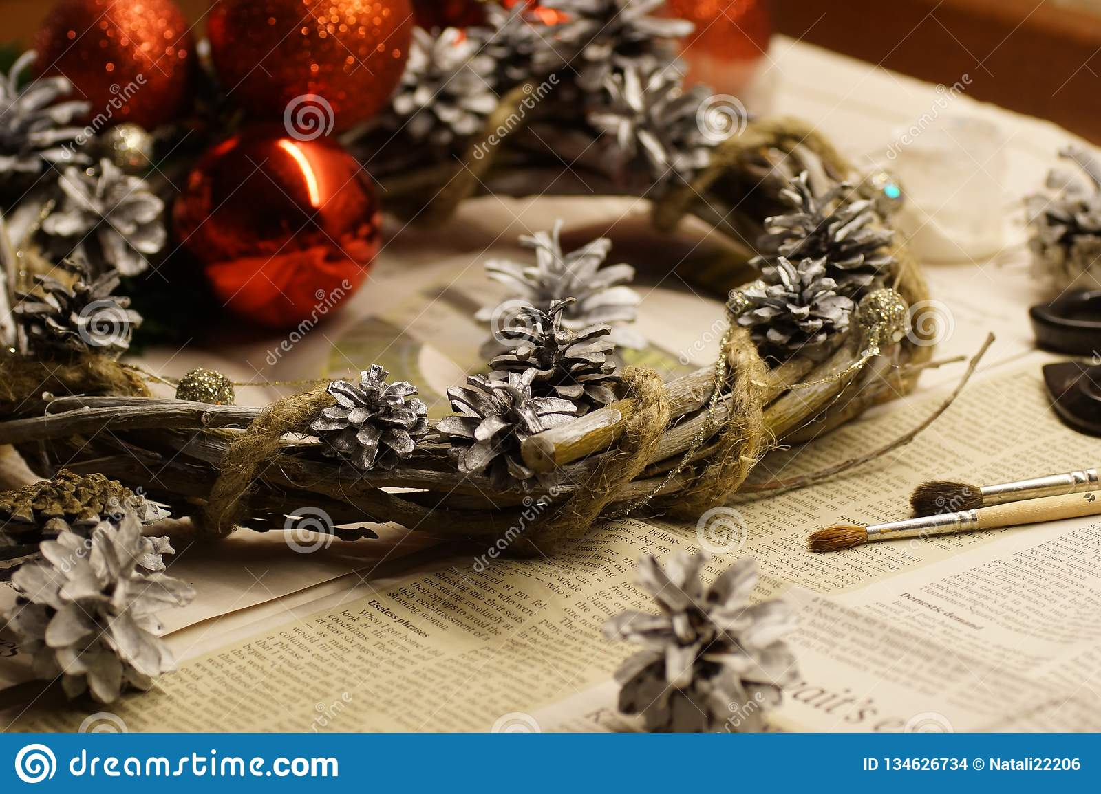 The process of making a Christmas wreath with his own hands. Advent wreath, or Advent crown, is a Christian tradition