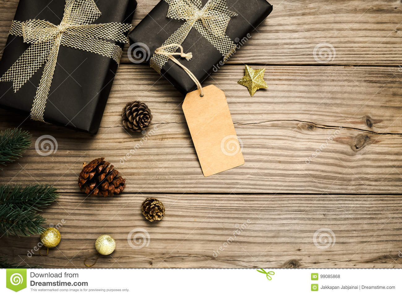 Christmas present gifts box and rustic decoration on vintage wooden background.