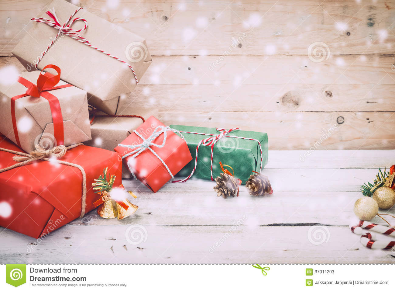 Christmas present gifts box and snow on wooden background