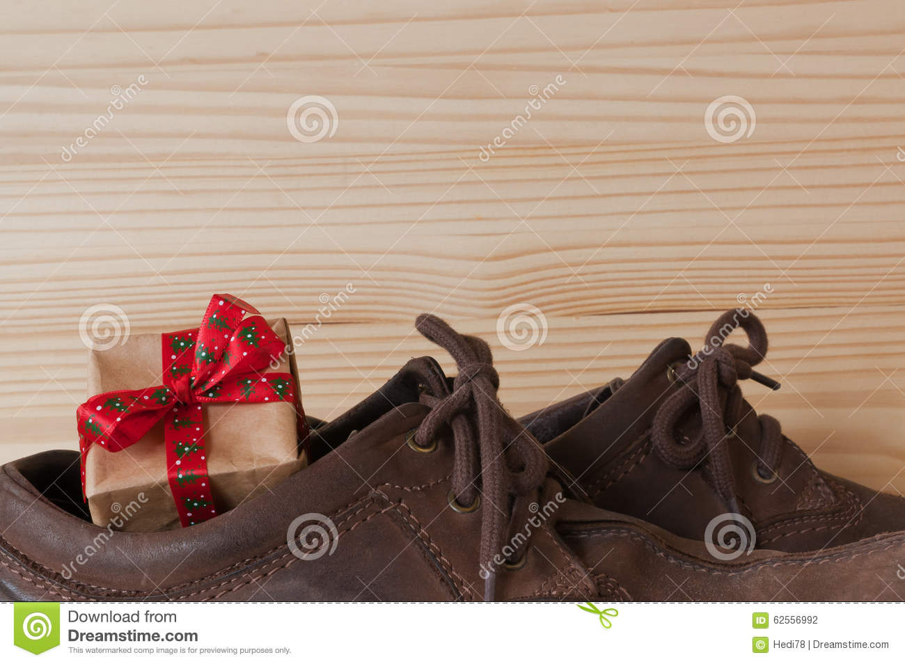 Christmas present in shoes stock photo image