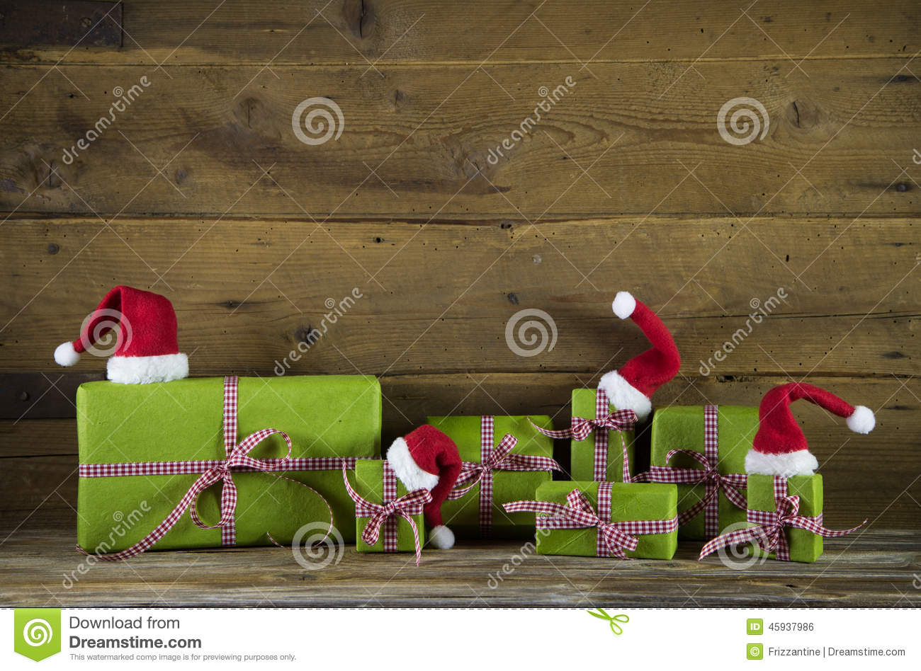 Christmas presents in apple green decorated with red santa hats