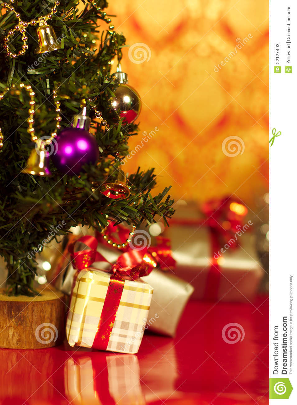 Download Christmas Presents Or Gifts Under Tree Vertical Stock Image