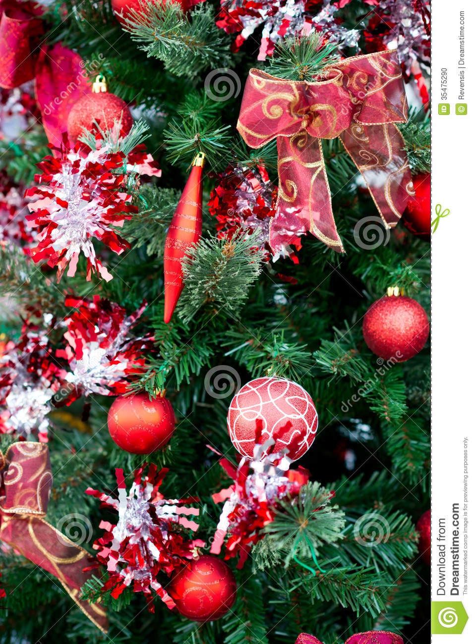 Christmas red balls decorations on tree stock