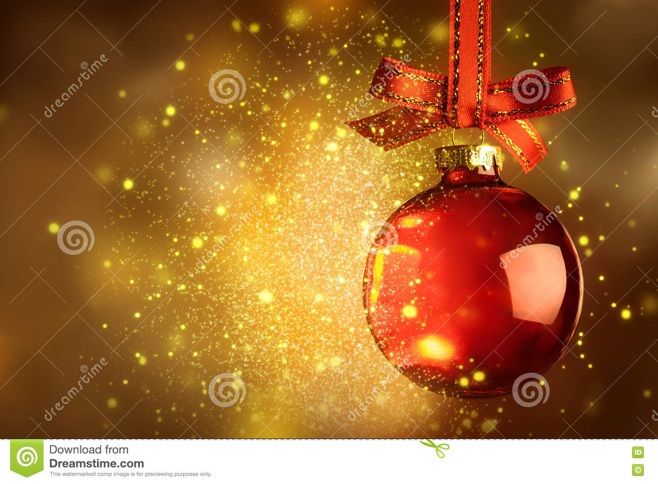 Christmas red bauble with sparkle over magic glitter shiny background