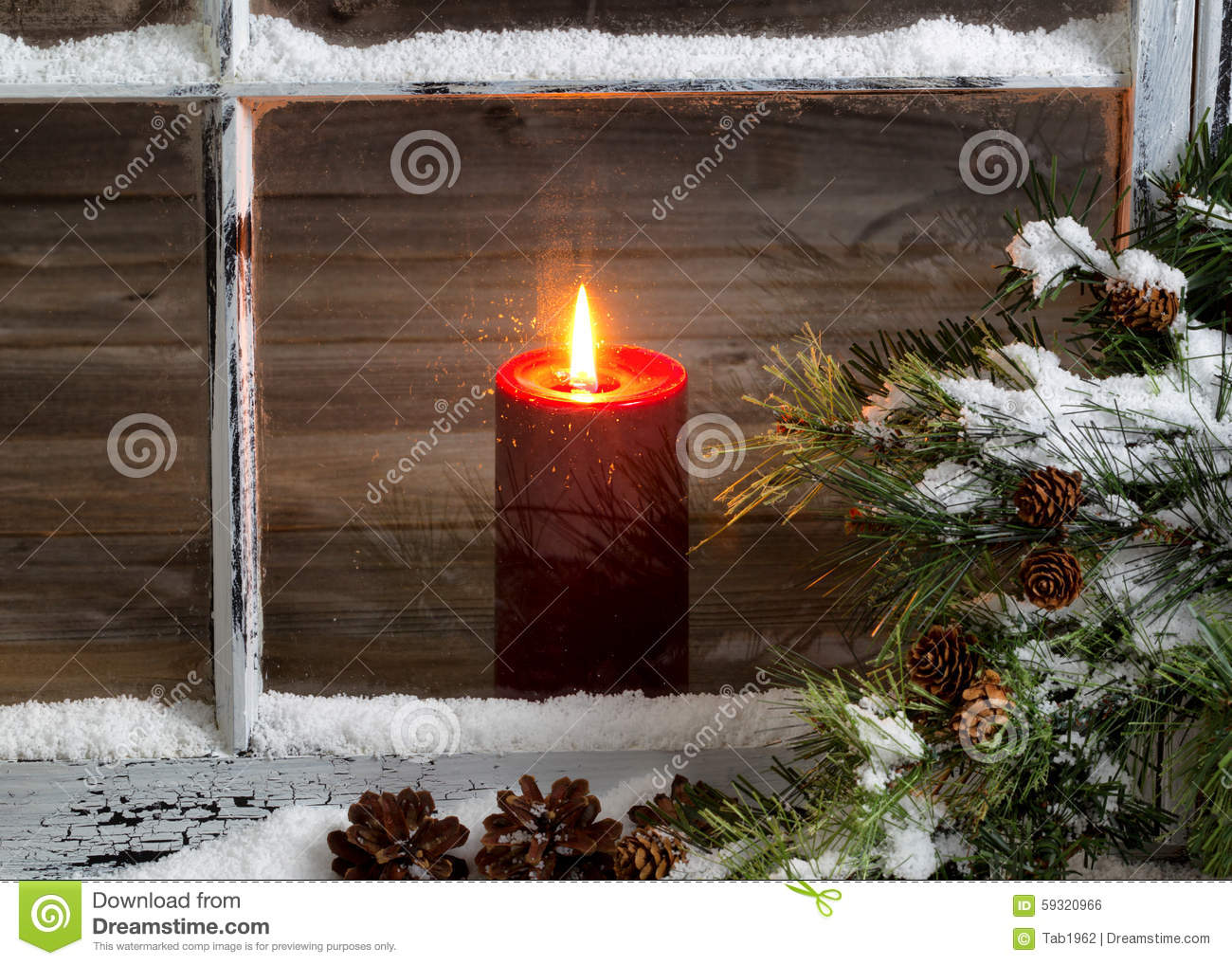Christmas Red Candle With Snow Covered Home Window And
