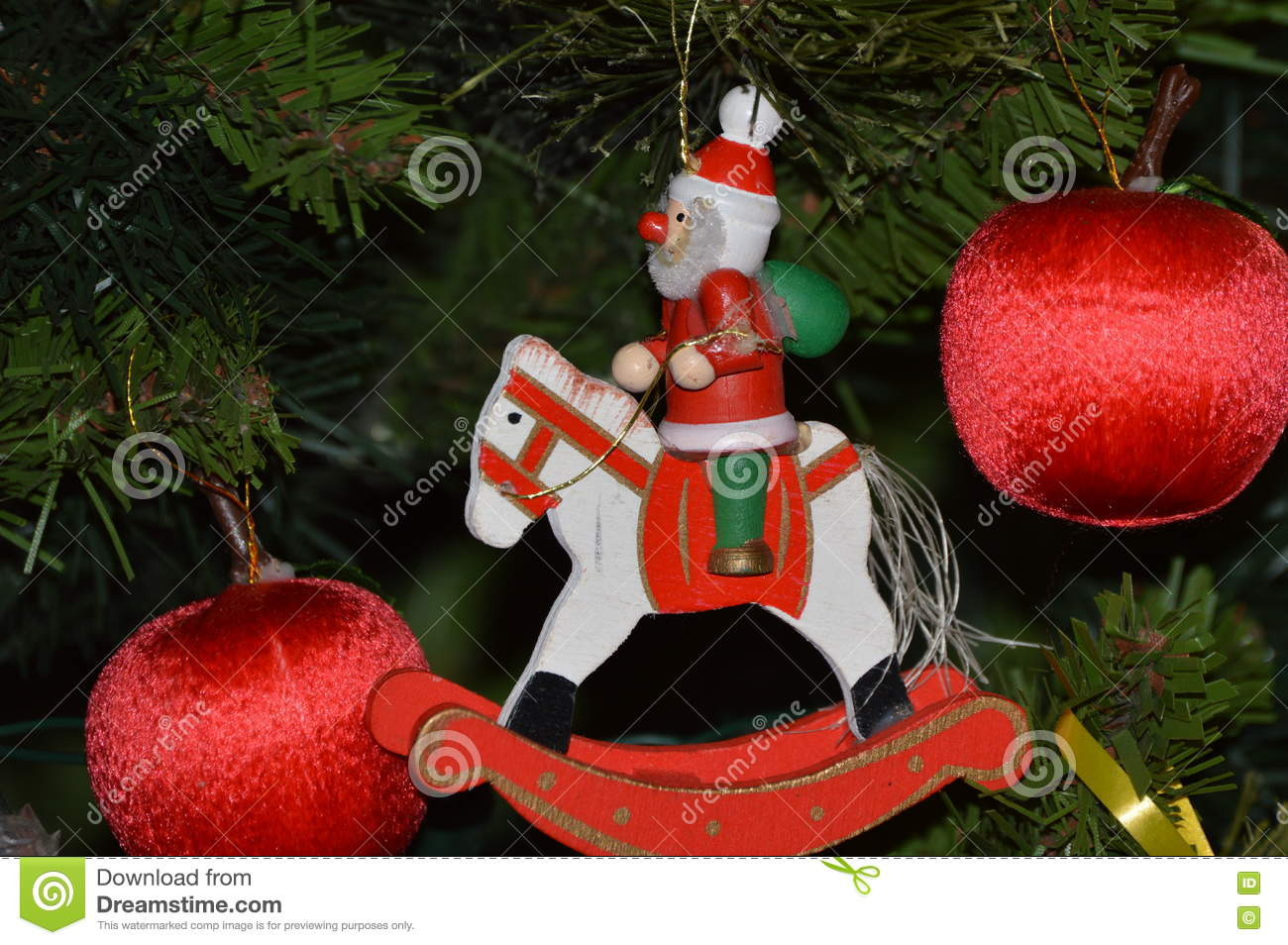 christmas red wooden man on horse and red globes decoration