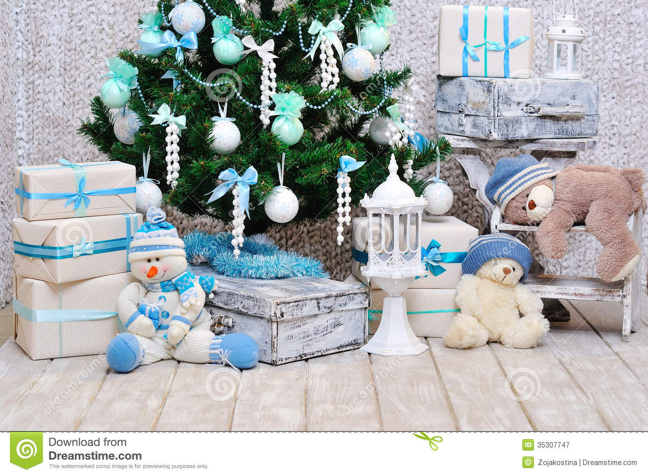 Closeup of cosy interior Christmas decoration with pine tree and teddy
