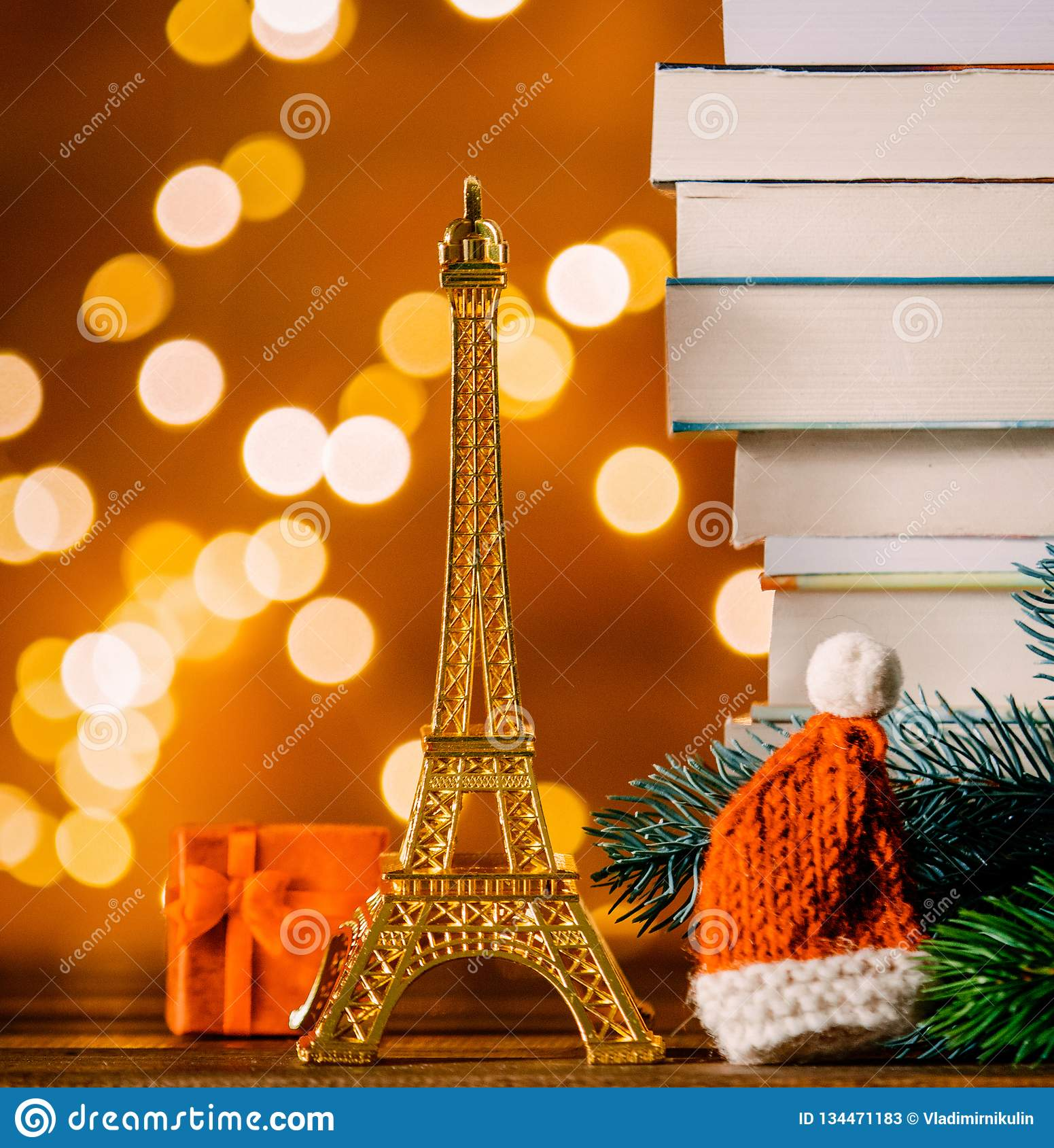 Christmas Santa Claus hat with Eiffel tower and pile of books