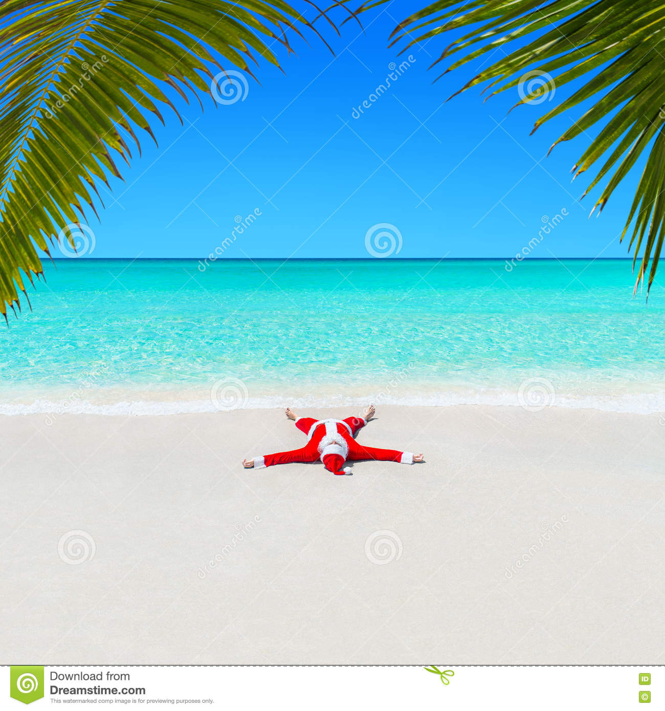 Christmas Santa Claus relaxing on sand at ocean palm beach