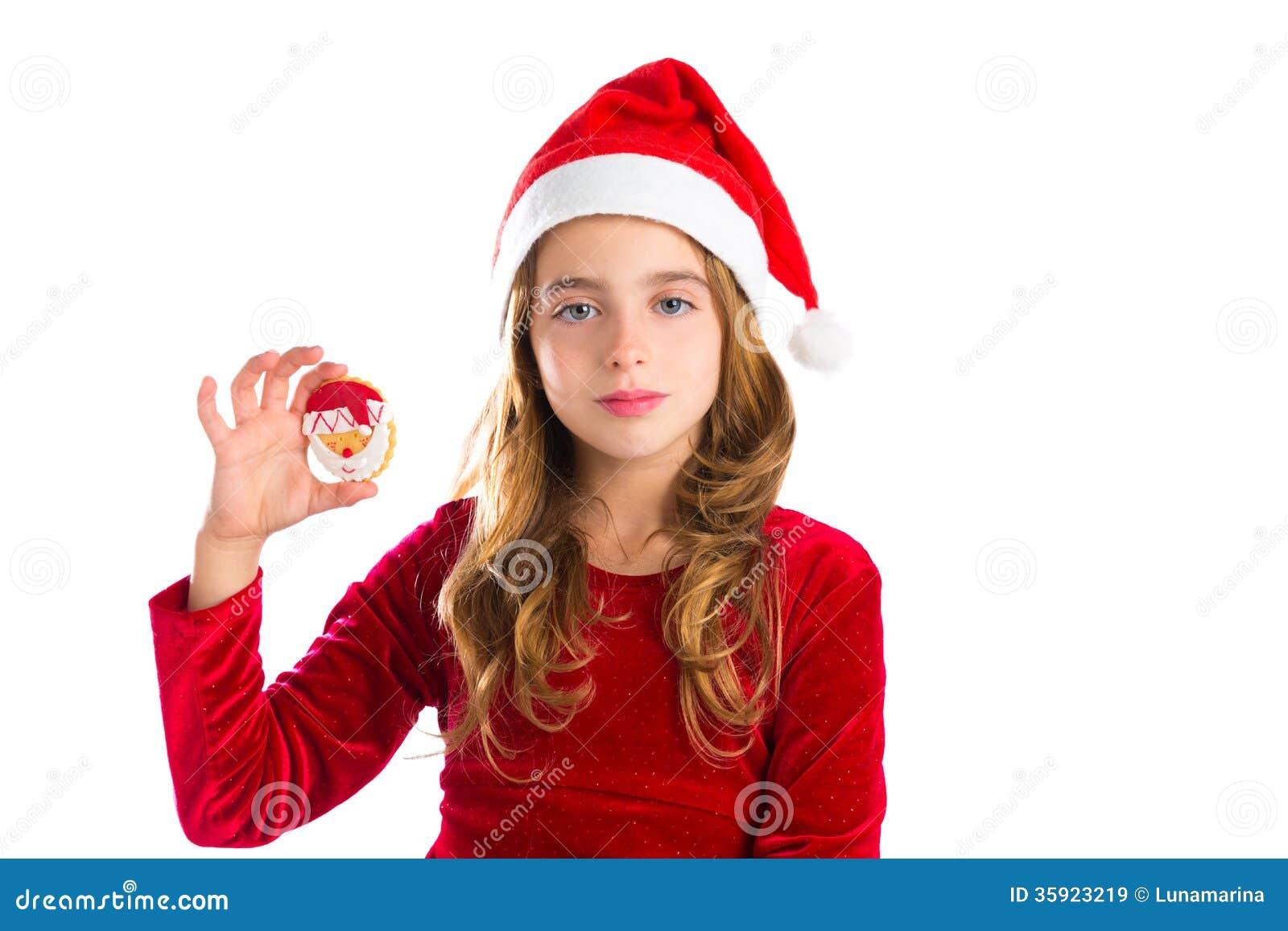 Christmas santa cookie and xmas dress kid girl royalty free stock