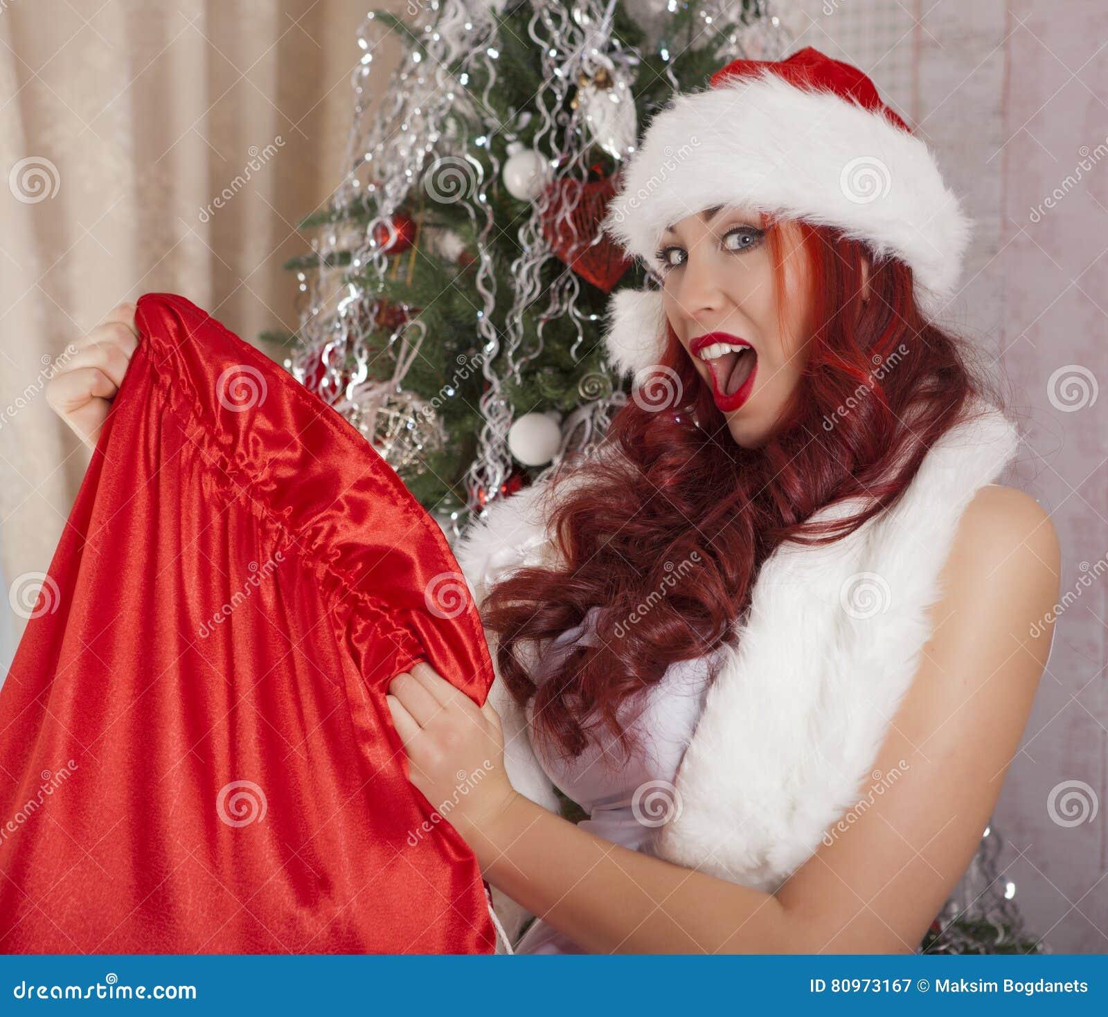 Christmas Babes.Christmas Santa Girl Opens Bag With Presents Surprise