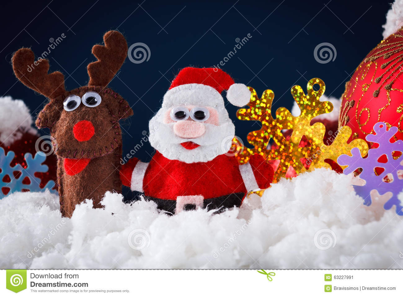 Christmas santa and reindeer toys on snow with festive new