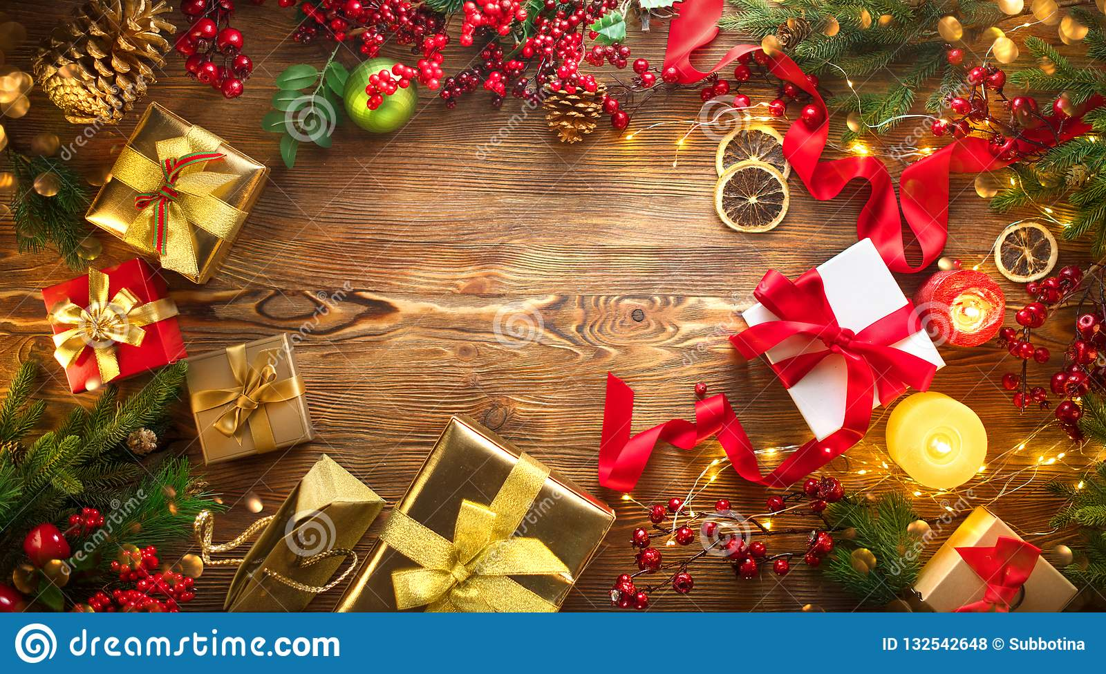 Christmas scene. Colorful wrapped gift boxes, beautiful Xmas and New Year backdrop with gift boxes, candles and lighting garland